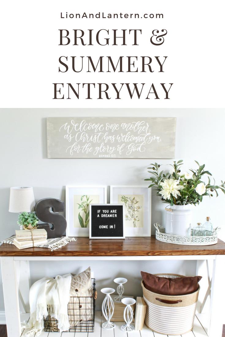 Summer Entryway Decor at LionAndLantern.com. Calligraphy sign, neutral decor, book bundles, texture, gray walls, farmhouse table.