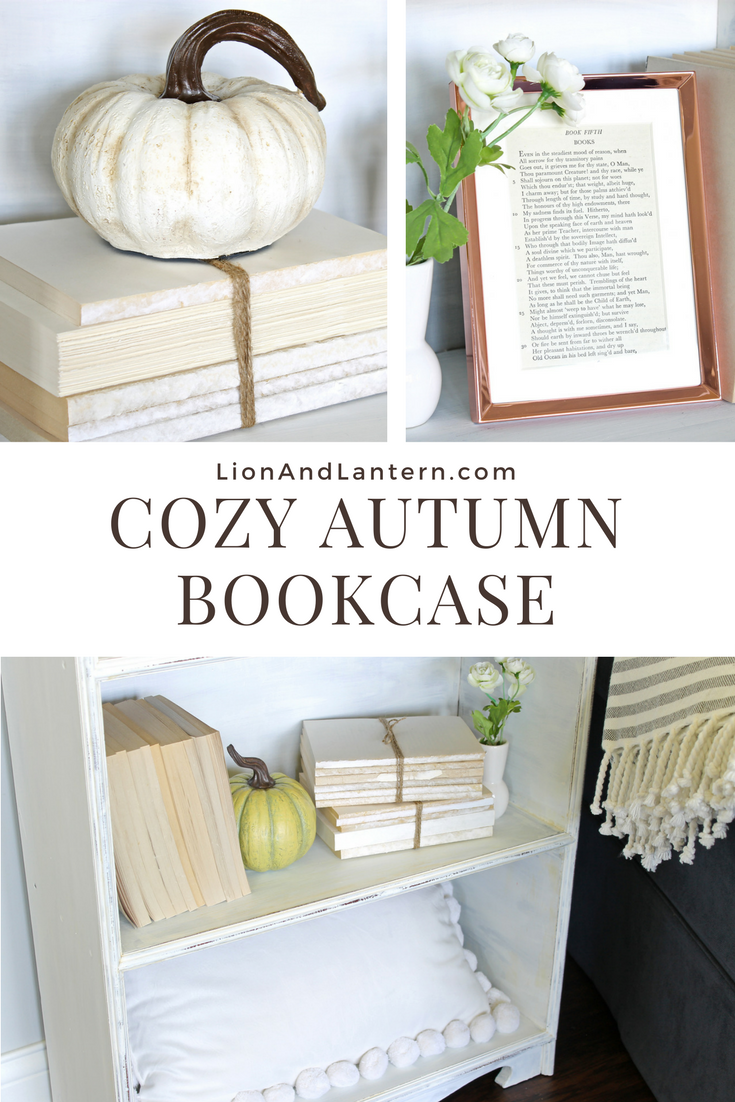 Cozy Autumn Bookcase Decor at LionAndLantern.com. Book bundle, neutral pumpkin, copper frame, pom pom pillow.