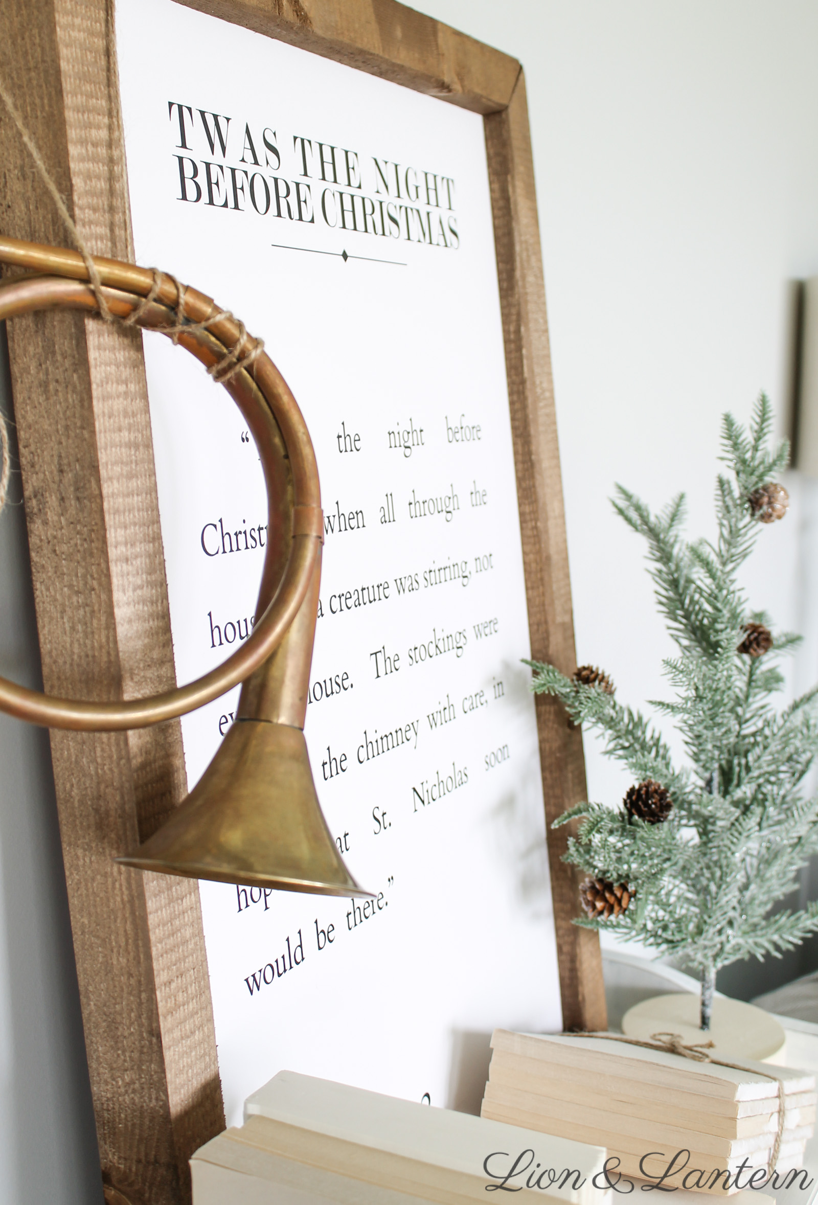 Rustic Christmas Bookshelf at LionAndLantern.com. Farmhouse Christmas, holiday decor, seasonal inspiration, farmhouse sign, neutral decor, basket, chalk painted bookshelf