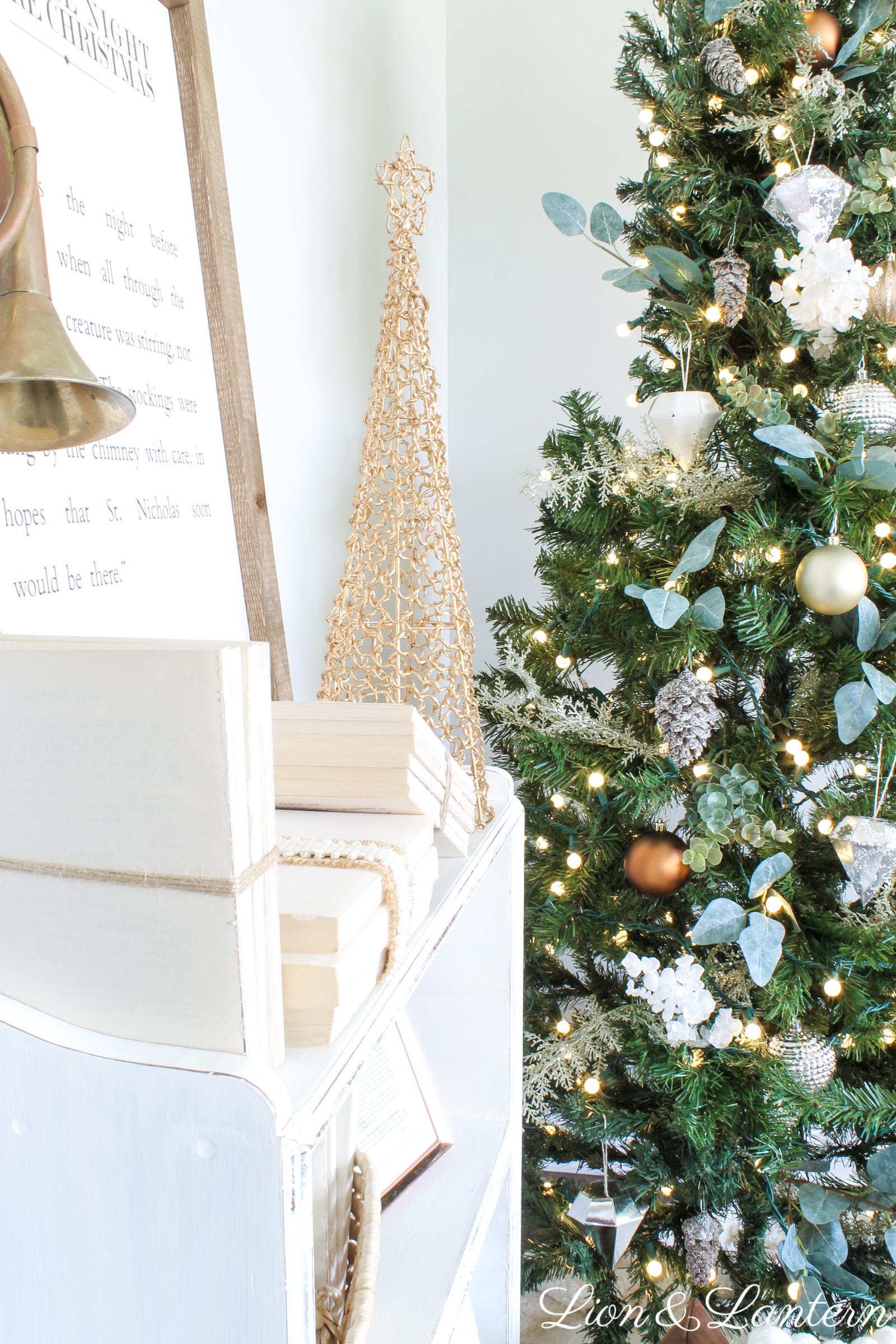 Simple Rustic Christmas Tree at LionAndLantern.com. Farmhouse Christmas, DIY Christmas decor, Christmas tree inspiration, eucalyptus, copper, gold, silver, pinecones
