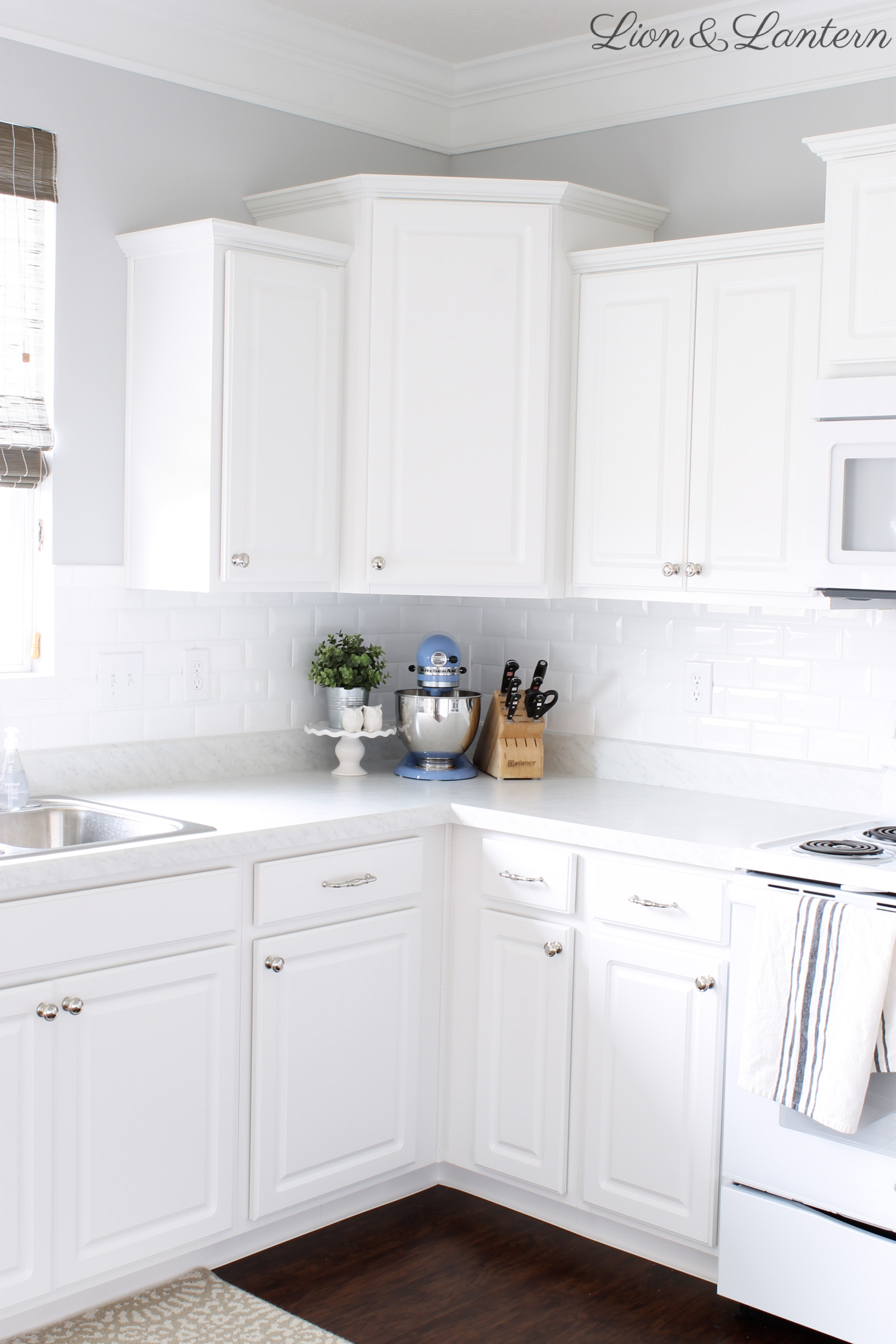 Builder Grade Kitchen Update at LionAndLantern.com | white subway tile, beveled subway tile, transitional kitchen, farmhouse kitchen, traditional kitchen, bright kitchen, white kitchen, DIY kitchen