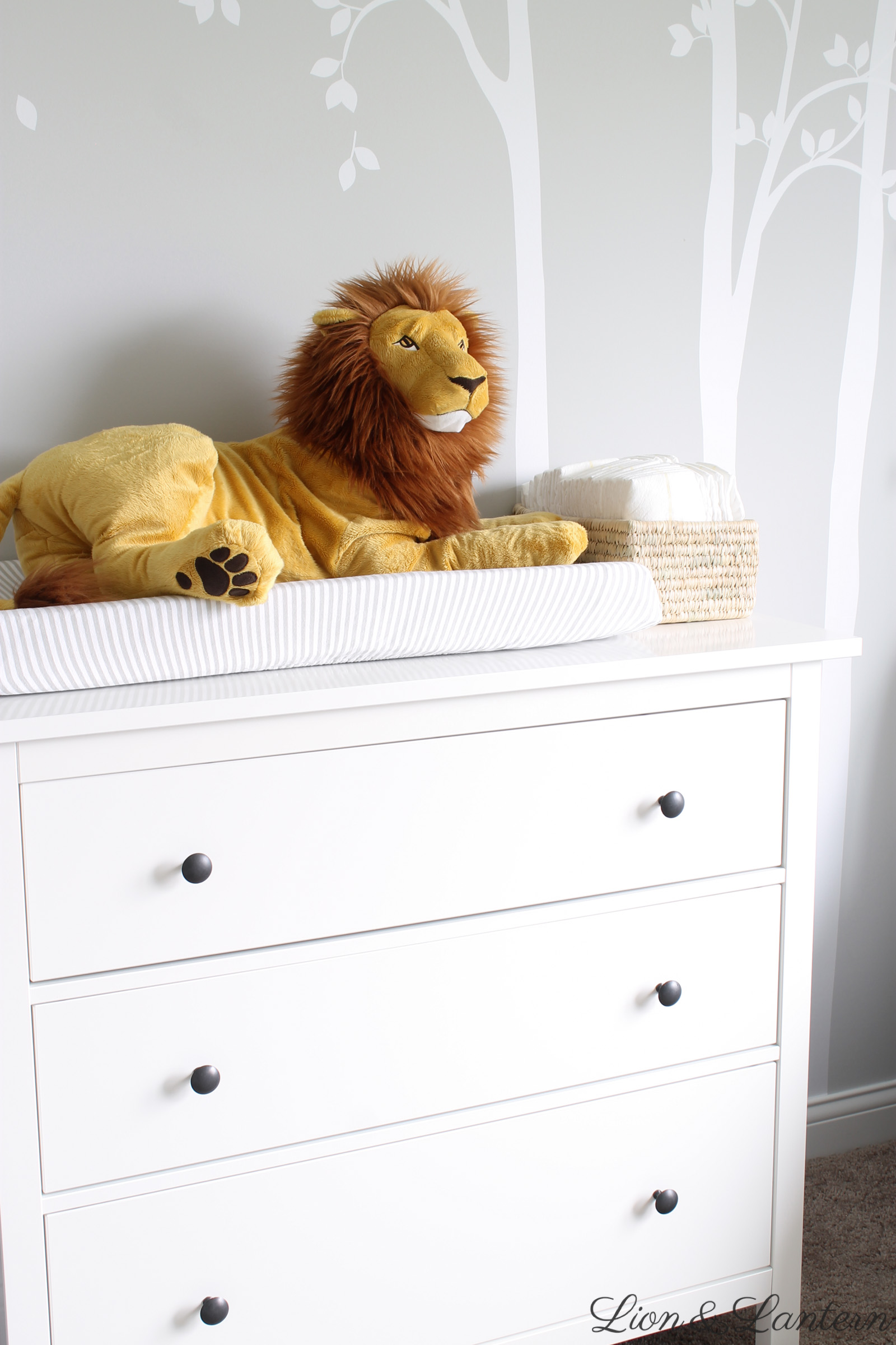 Narnia Inspired Bright & Sweet Nursery Tour at LionAndLantern.com | dresser, soft, pastel, modern, IKEA picture ledge, book ledge, rainbow baby, kids room, organized, clean