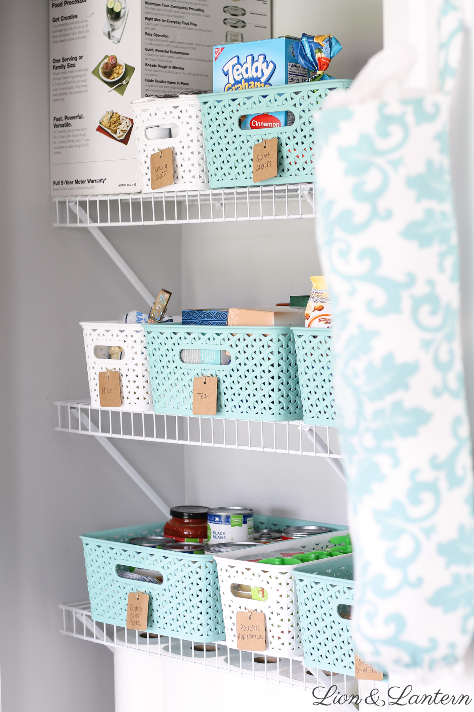 Simple Pantry Organization at LionAndLantern.com | pantry bins, budget organizing, spark joy, Target y weave baskets, food organization