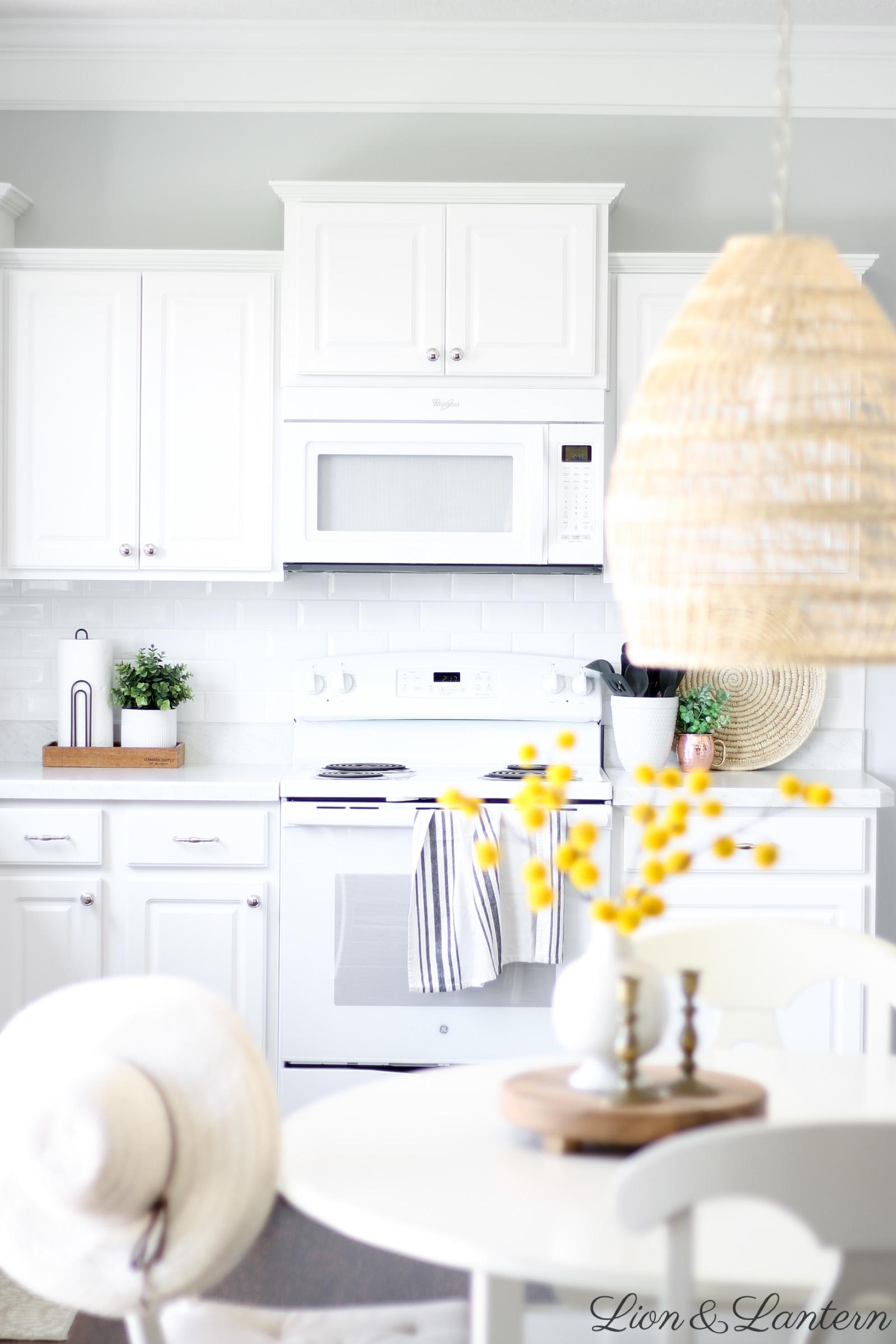 Fall Kitchen & New Textured Pendant Light at LionAndLantern.com | fall decor, autumn decor, fall inspiration, white subway tile, white kitchen, white appliances, seagrass tray