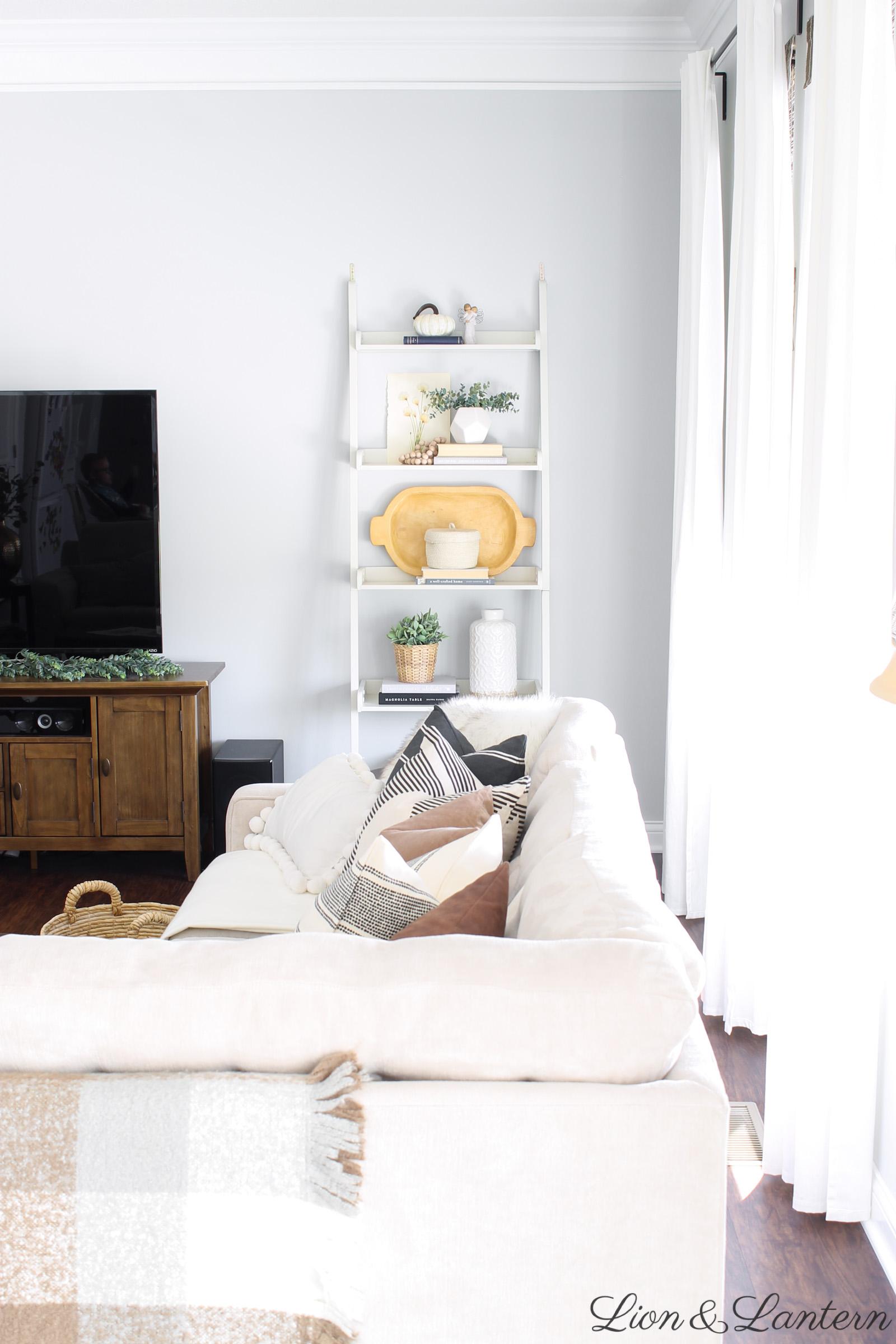 Fall Living Room at LionAndLantern.com | fall shelf styling, autumn decor, fall home decor, fall throw pillows, pillow covers, boho chic, modern farmhouse, ladder shelf