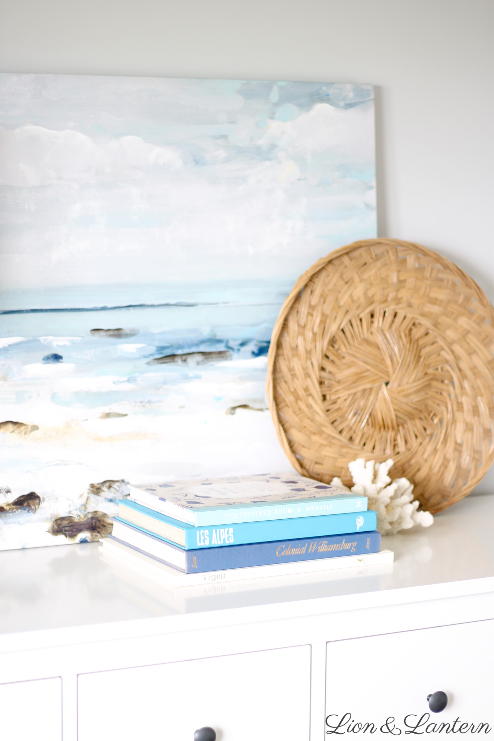 Modern Coastal Master Bedroom at LionAndLantern.com | coastal farmhouse, boho, minimalist, California, IKEA Hemnes dresser, white bedding, thrifted decor, upholstered headboard, baskets, books