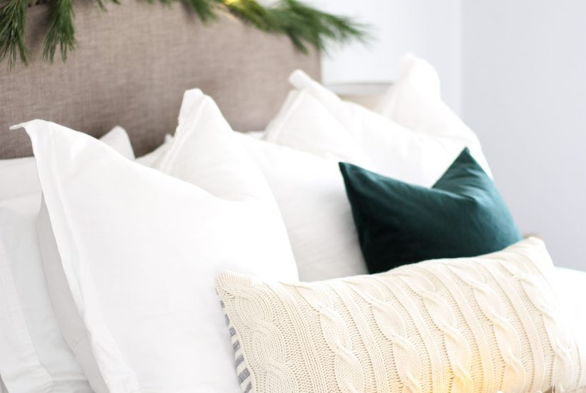 Cozy Christmas Bedroom Decor at LionAndLantern.com | modern Christmas, Scandinavian Christmas, minimalist, modern farmhouse style, simple decor, pine garland, velvet pillow