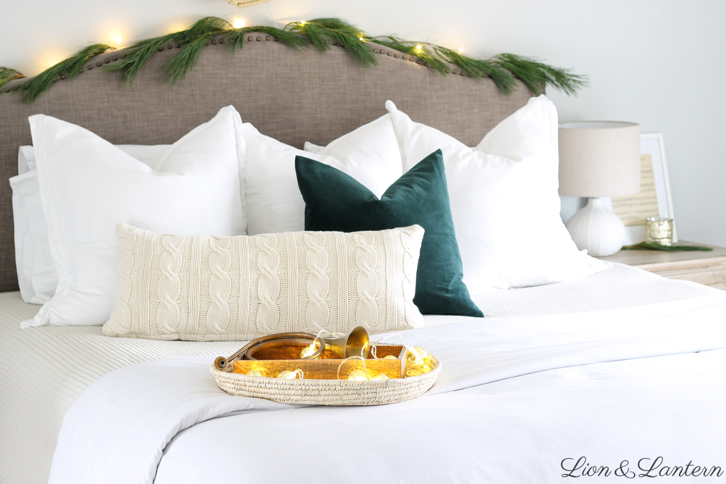 Cozy Christmas Bedroom Decor at LionAndLantern.com | modern Christmas, Scandinavian Christmas, minimalist, modern farmhouse style, simple decor, pine garland, velvet pillow