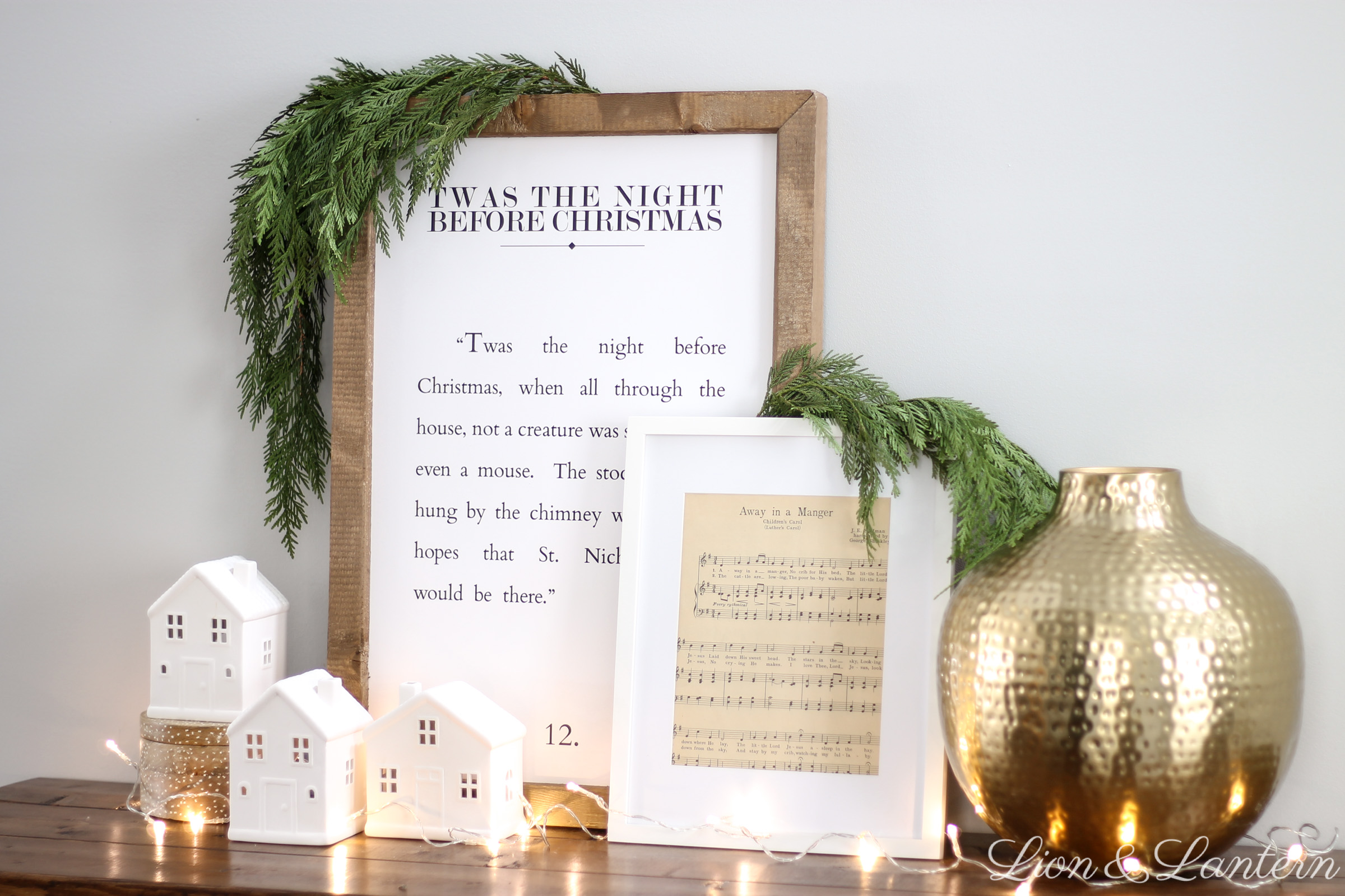 Simple Classic Christmas Entryway at LionAndLantern.com | modern farmhouse Christmas, minimalist, fresh cedar, white houses, vintage sheet music, Ana White rustic x console table, Christmas sign