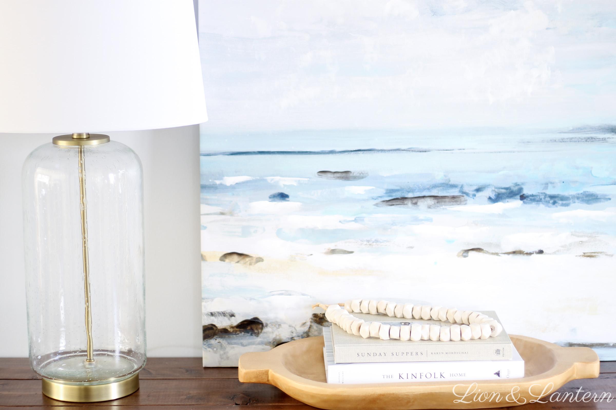 Easy Coastal Entryway Styling at LionAndLantern.com | coastal farmhouse, casual decor, modern, minimalist, bone beads, ocean painting, Ana White rustic x console