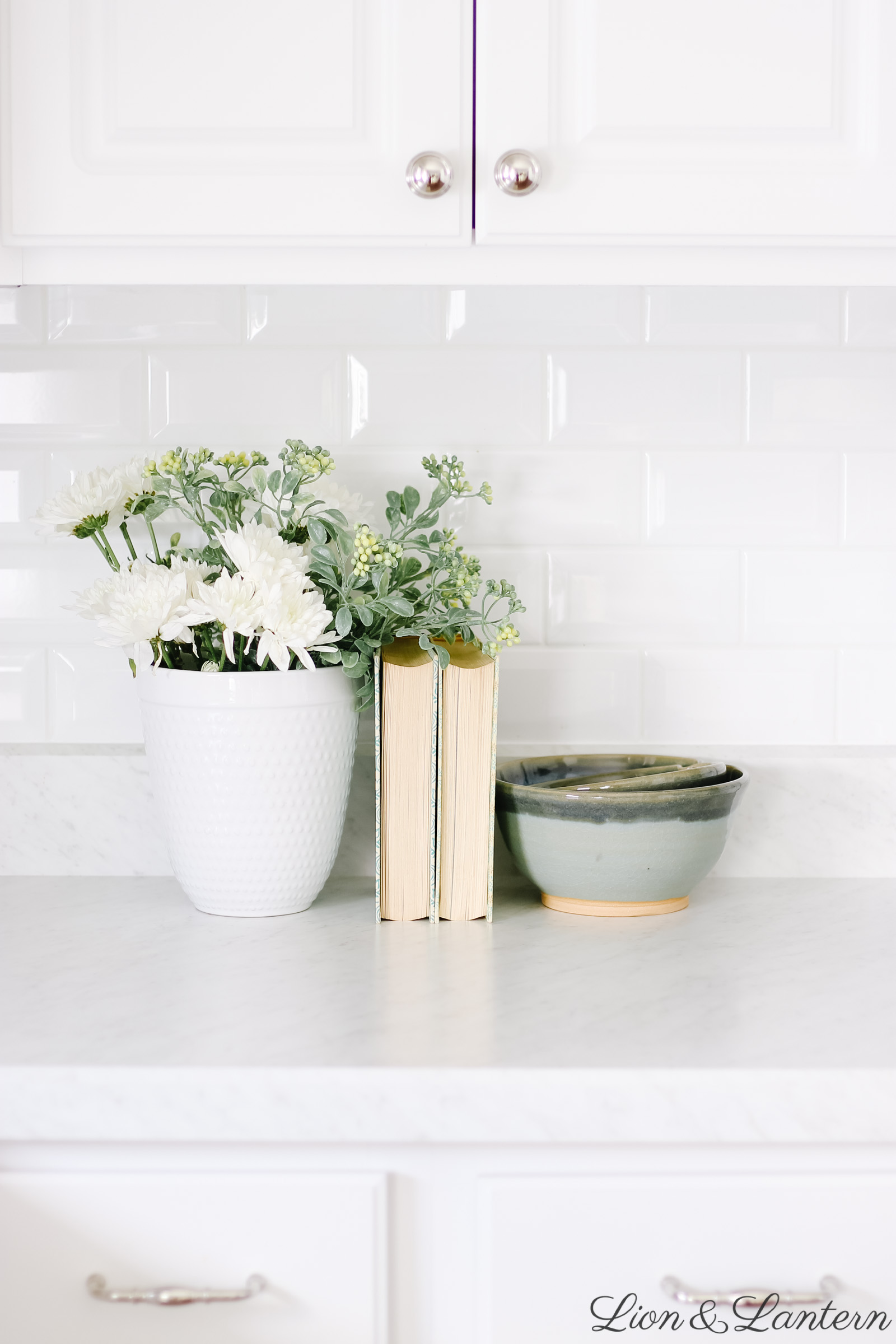 White Kitchen Tips: Adding Character on a Budget at LionAndLantern.com | vintage kitchen decor, vintage books, coastal home, white subway tile, budget decorating, neutral kitchen