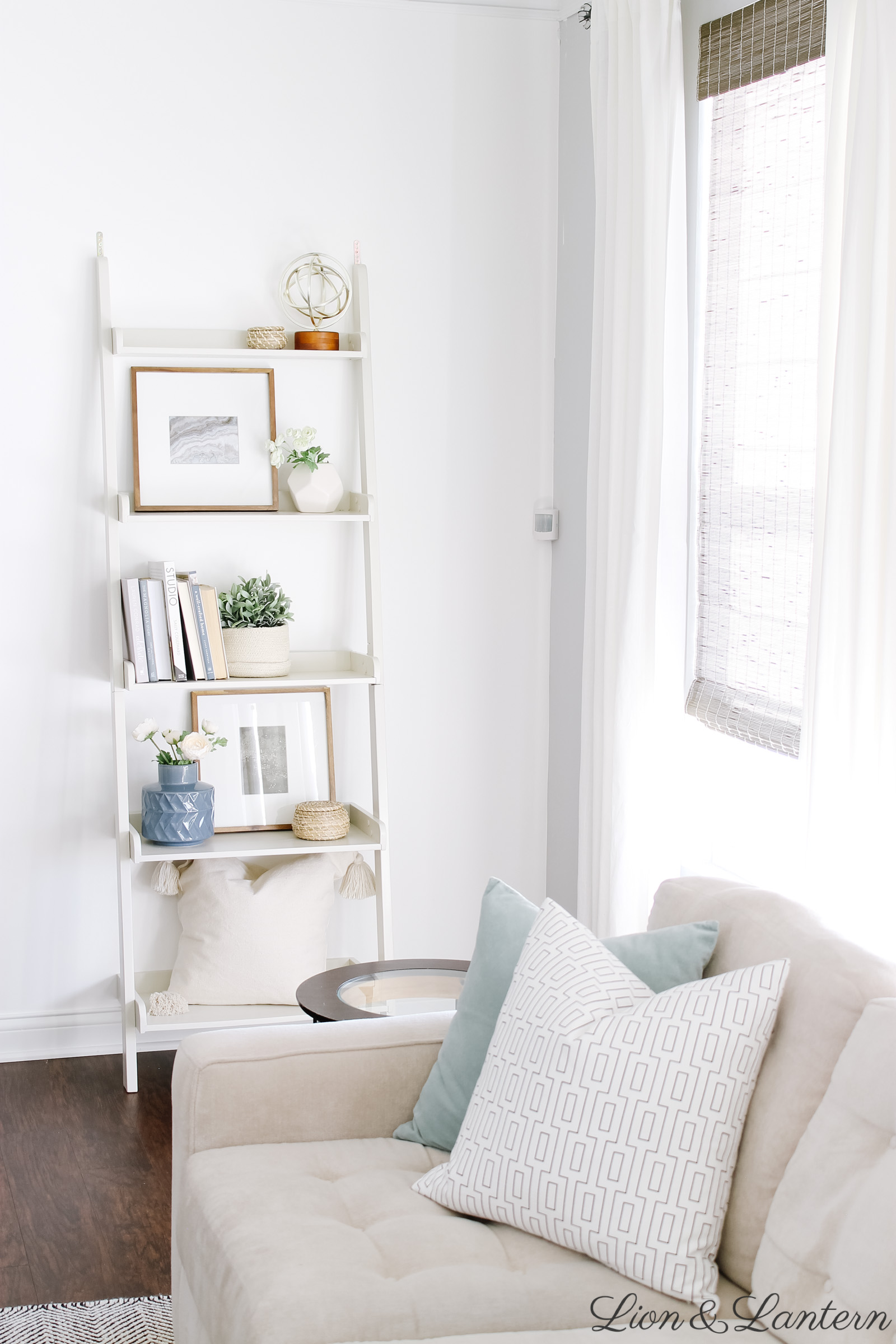 Spring Home Tour 2019 at LionAndLantern.com | spring living room decor, eucalyptus, modern accent chairs, budget decorating, neutral living room, ladder shelf, shelf styling