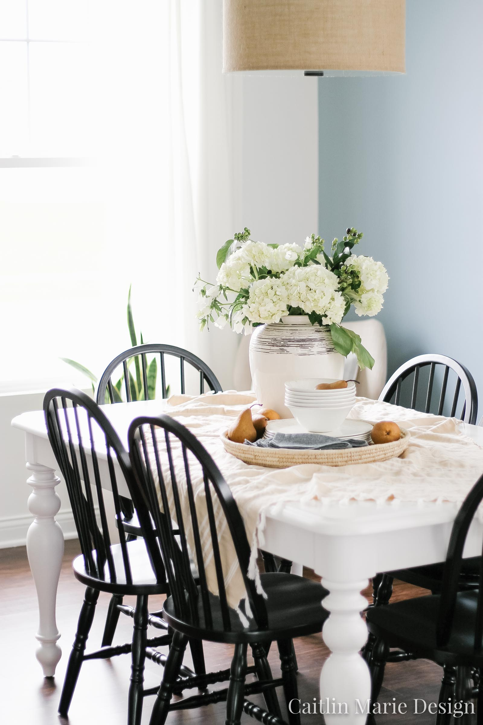 Simple Summer Tablescape | hydrangeas, pears, coastal farmhouse, blue dining room, minimalist abstract art, black dining chairs