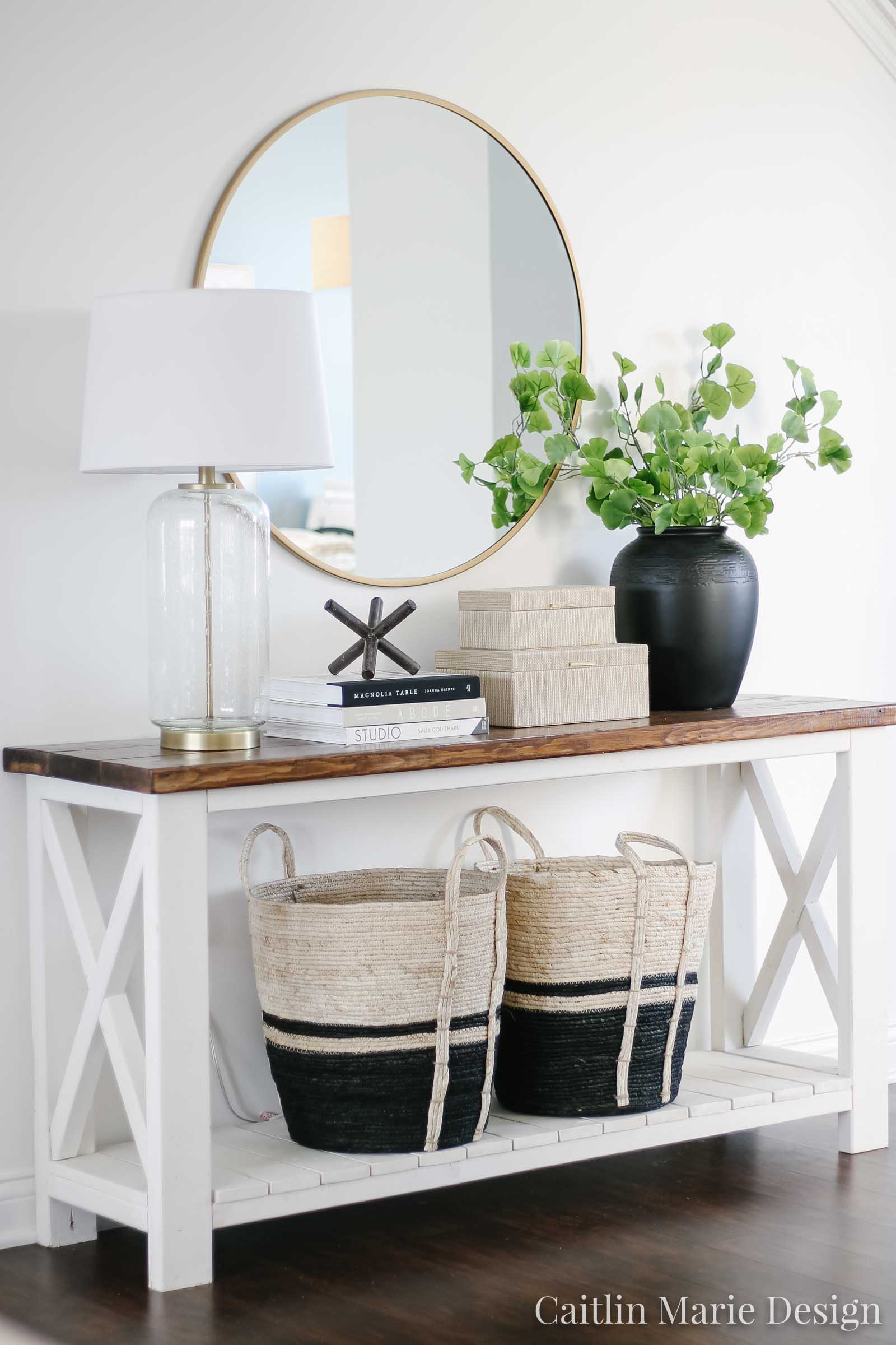 Entryway Styling Ideas | entry console table decor, round brass mirror, modern traditional decor, modern boho, black vase, large baskets, Ana White rustic x console