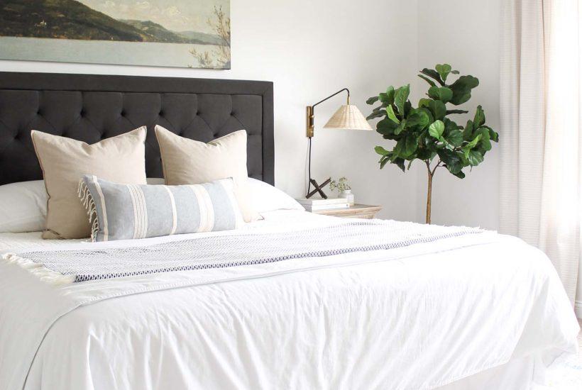 Bedroom Sconces - Coastal Master Bedroom Update | wicker rattan sconce, coastal decor, landscape art above the bed, weathered wood nightstand, charcoal headboard, coastal farmhouse