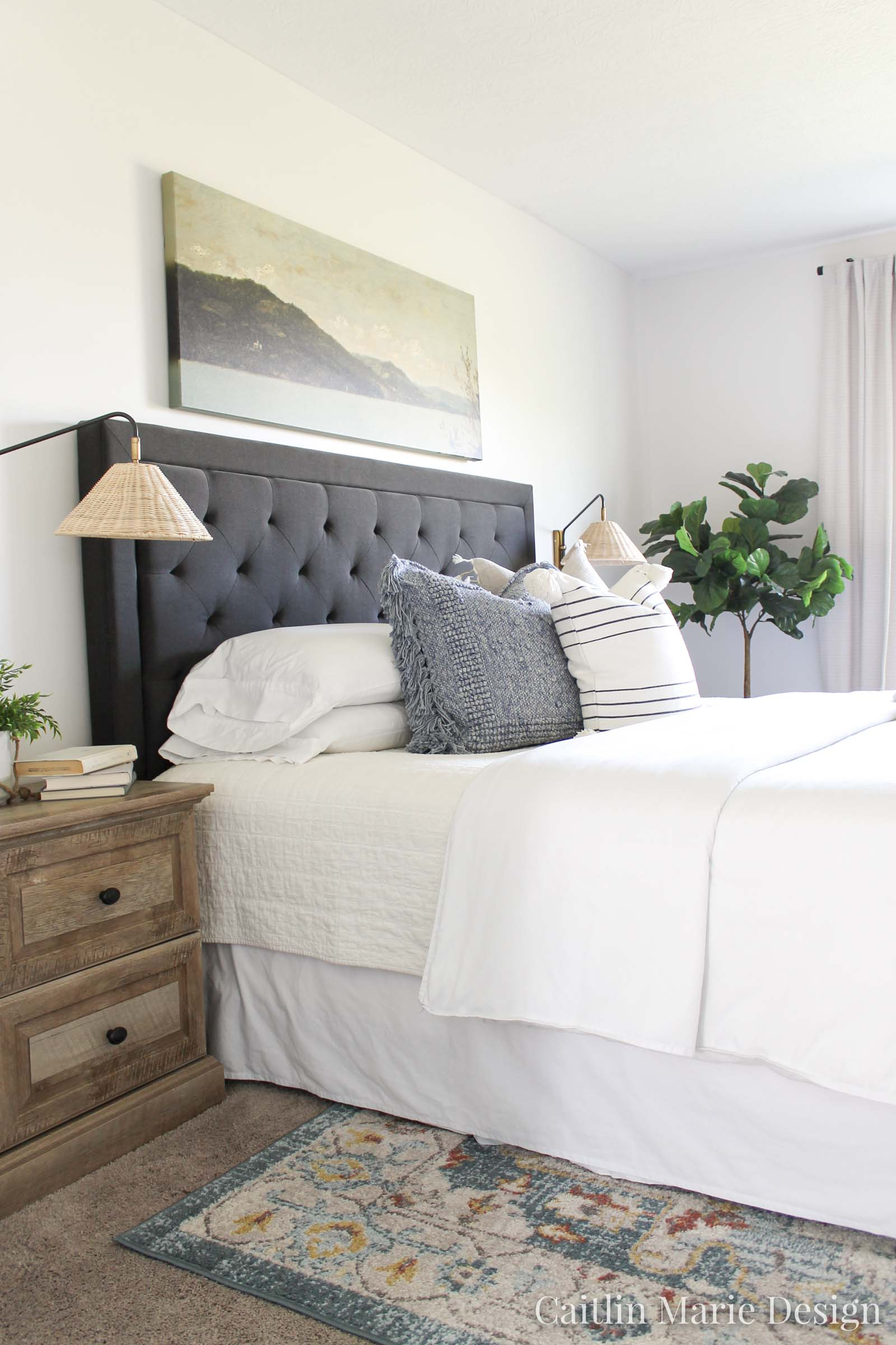 Coastal Home Decor Refresh with Serena & Lily | coastal bedroom, rattan plug in wall sconces, dark headboard, neutral bedroom decor, wide art above the bed, vintage landscape painting