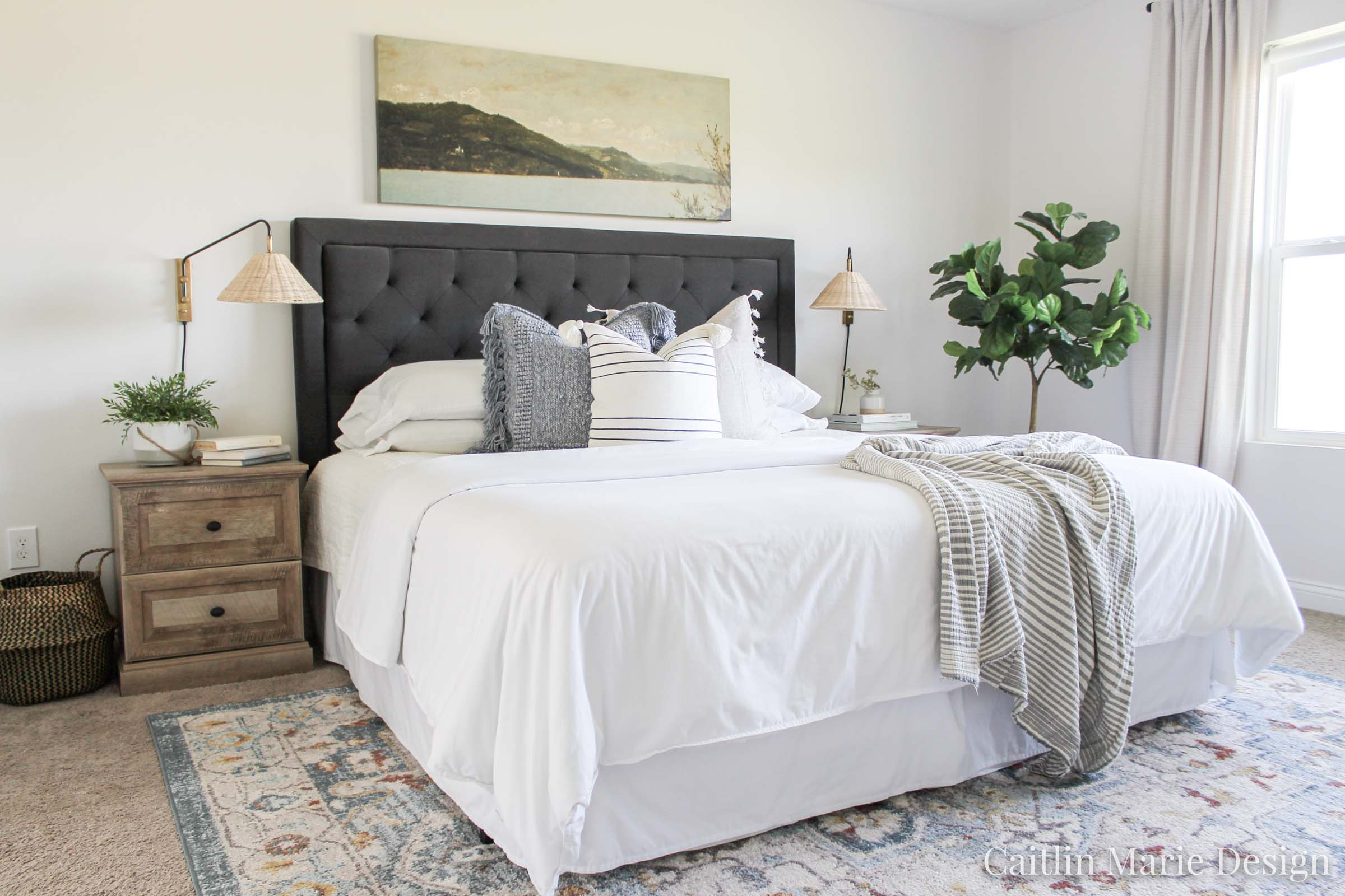 Coastal Pillow Refresh with Serena & Lily | coastal bedroom, rattan plug in wall sconces, dark headboard, neutral bedroom decor, wide art above the bed, vintage landscape painting