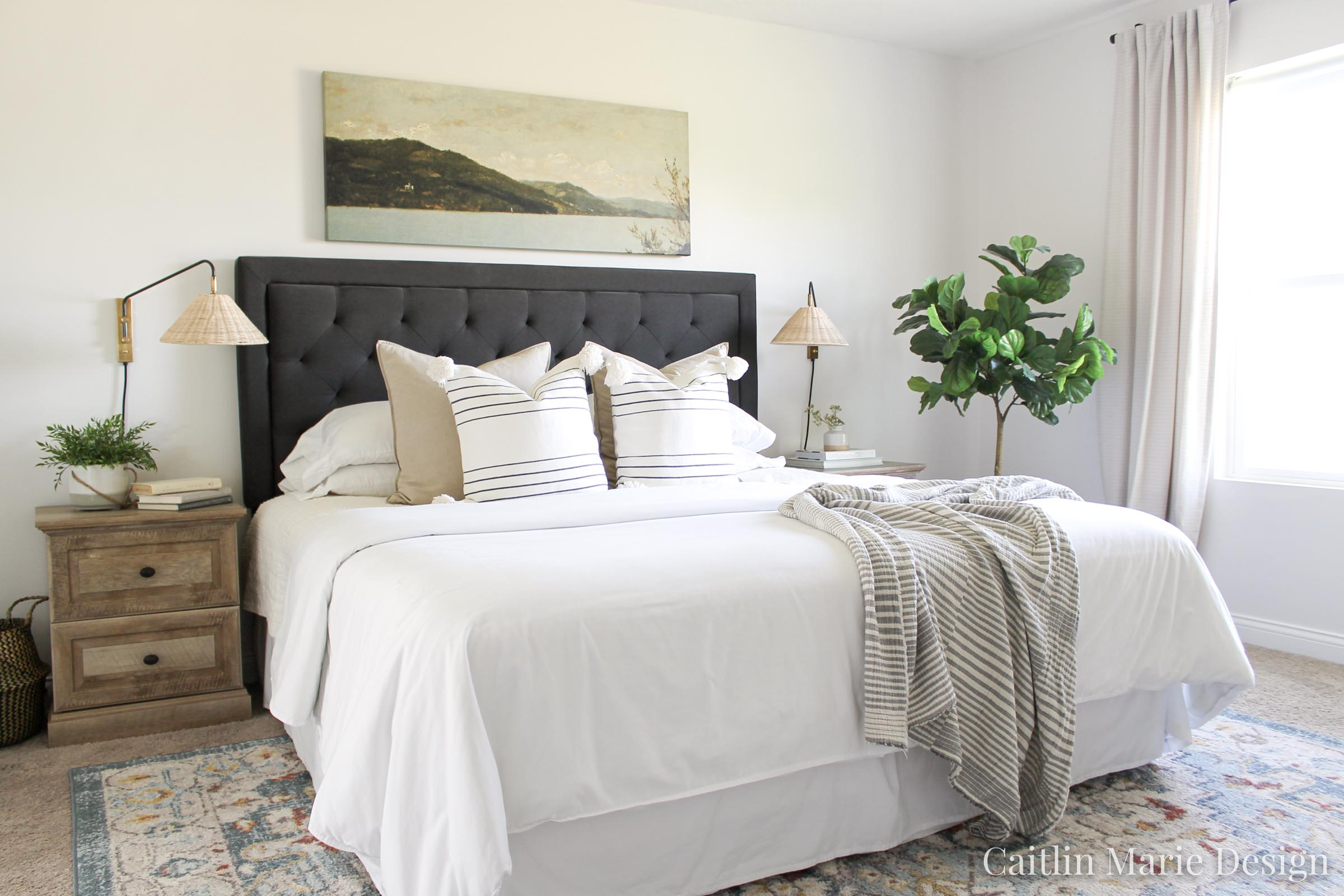 Coastal Decor Refresh with Serena & Lily | coastal bedroom, rattan plug in wall sconces, dark headboard, neutral bedroom decor, wide art above the bed, vintage landscape painting