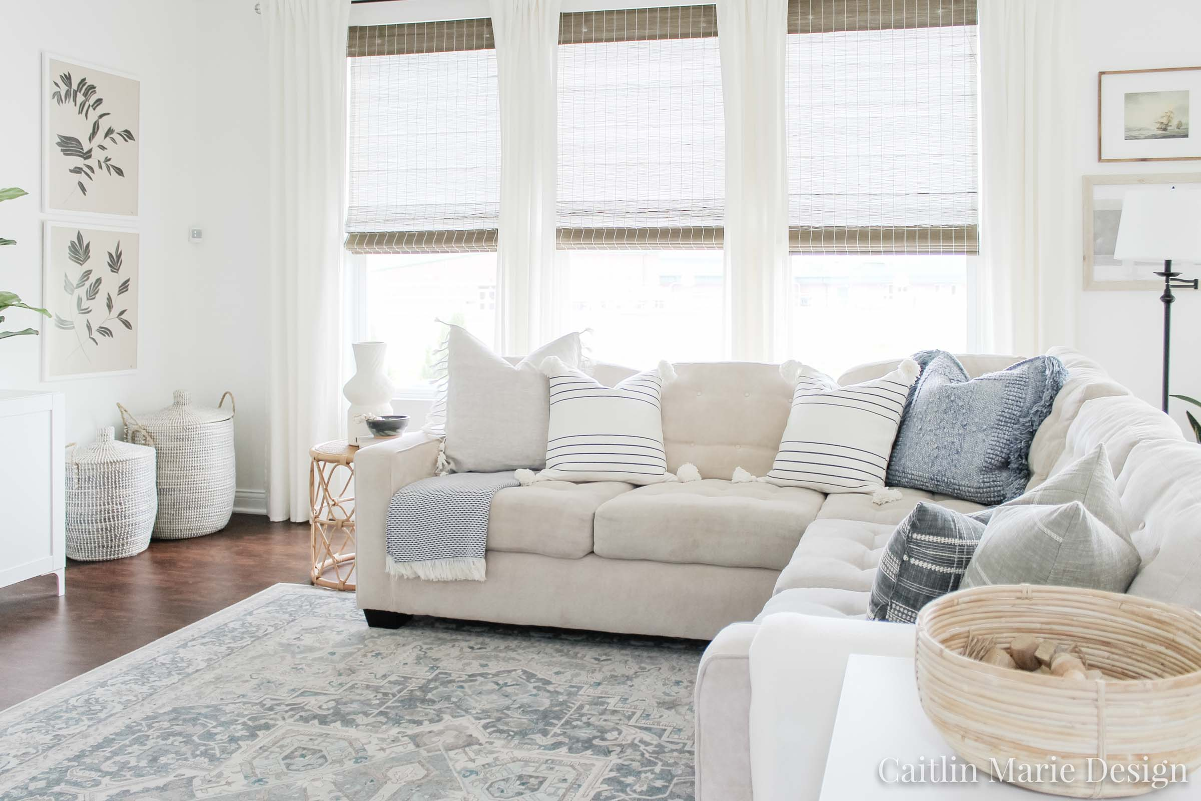 Coastal Pillow Refresh with Serena & Lily | coastal living room, light and airy decor, olive tree, rattan side table, Serena & Lily pillows, coastal decor