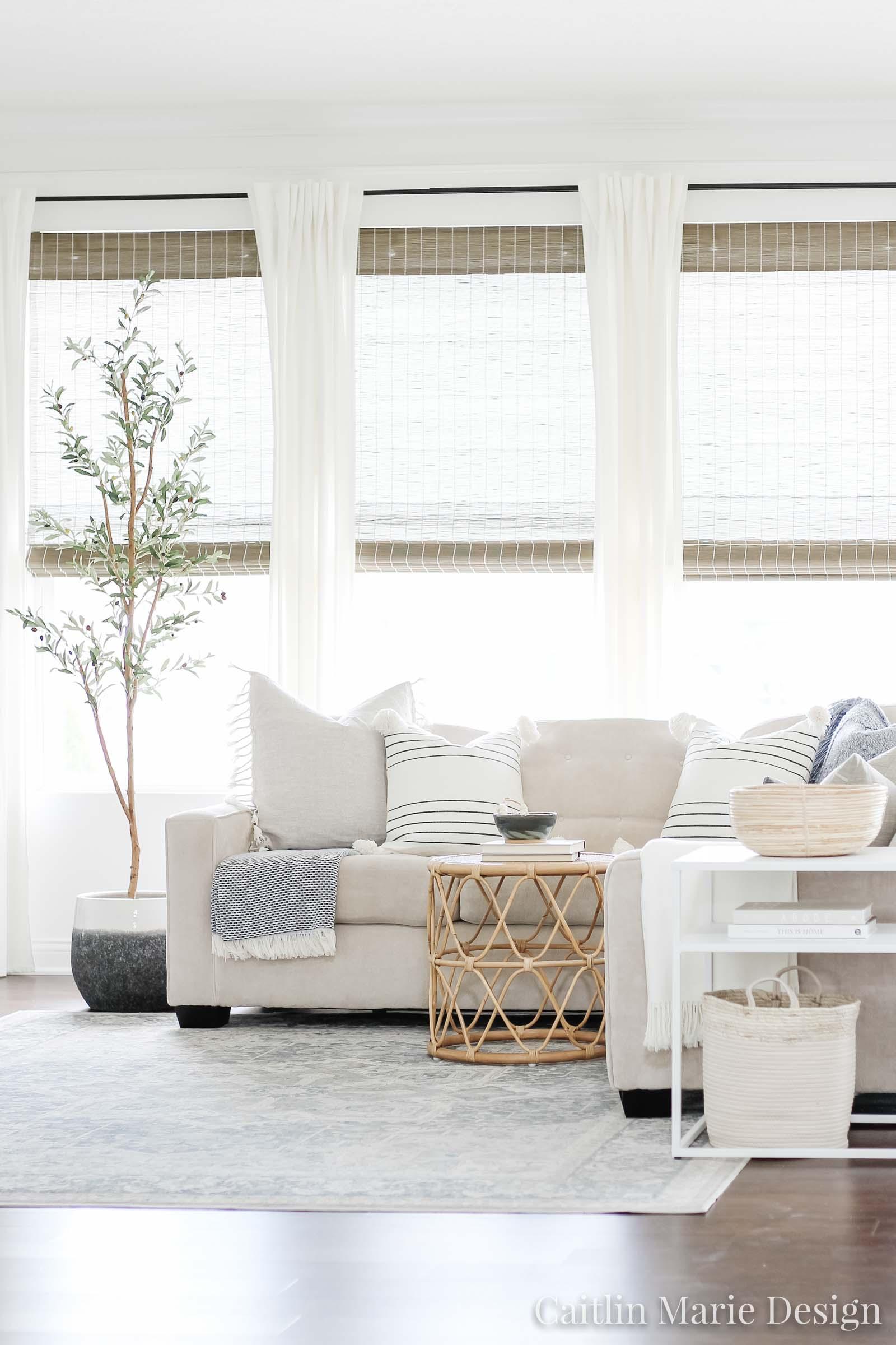 Coastal Decor Refresh with Serena & Lily | coastal living room, light and airy decor, olive tree, rattan side table, Serena & Lily pillows, coastal decor