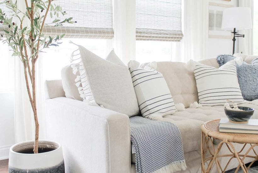 Coastal Home Decor Refresh with Serena & Lily | coastal living room, light and airy decor, olive tree, rattan side table, Serena & Lily pillows, coastal decor
