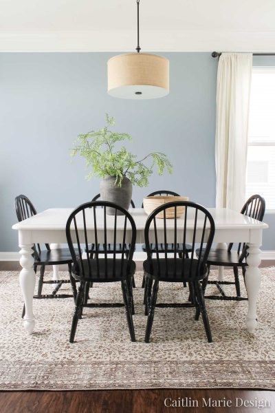 Vintage Rug in the Dining Room | Revival Rugs, modern traditional decor, coastal home, black Windsor chairs, white farmhouse table