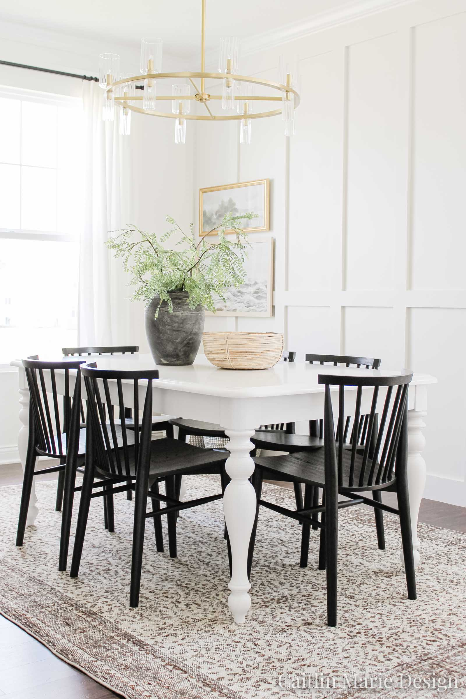 Modern Dining Chair Update with Article | coastal modern dining room, brown vintage rug, landscape art, aged stone vase, board and batten accent wall