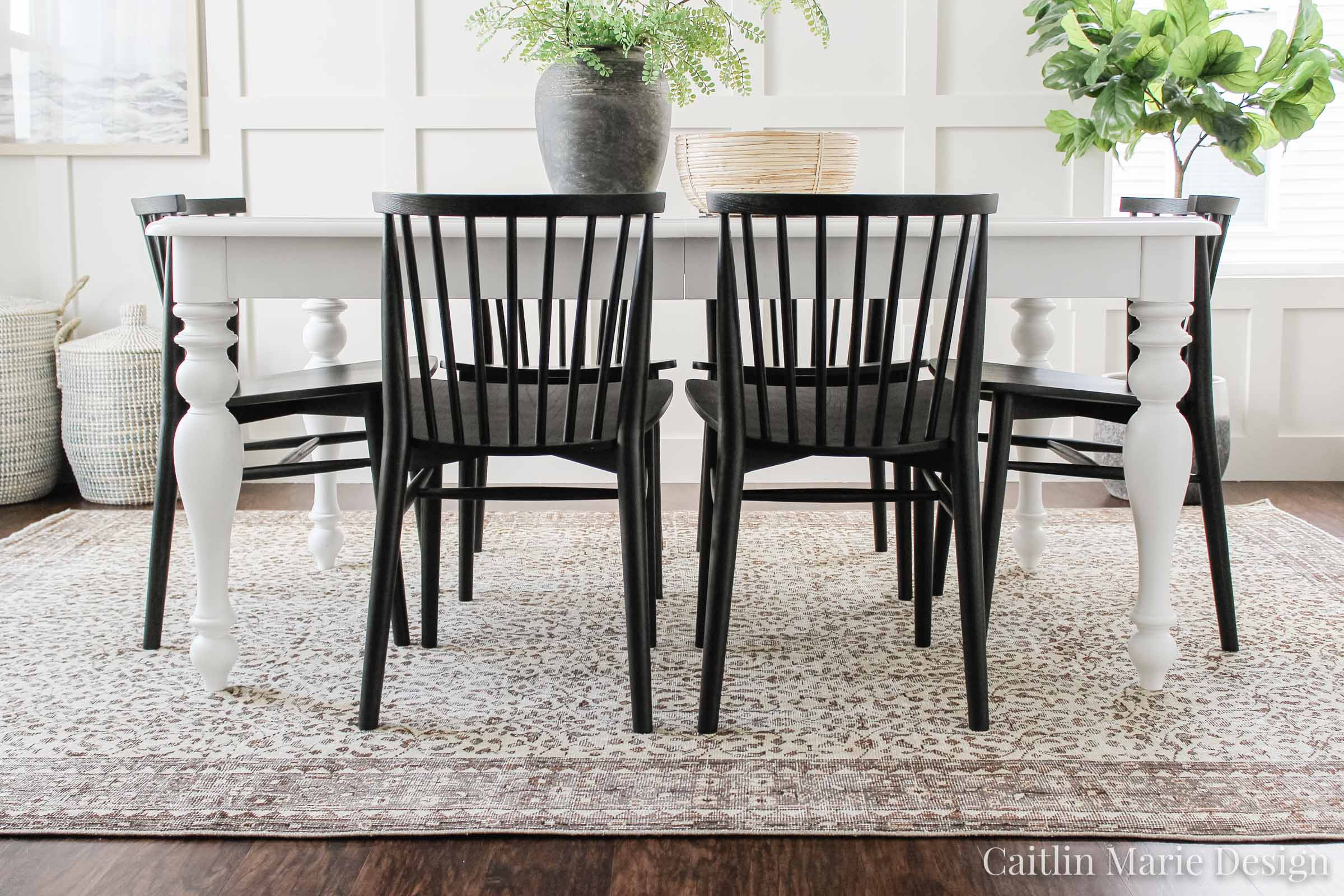 Modern Dining Chair Update with Article | coastal modern dining room, Windsor chair, brown vintage rug, landscape art, aged stone vase, board and batten accent wall