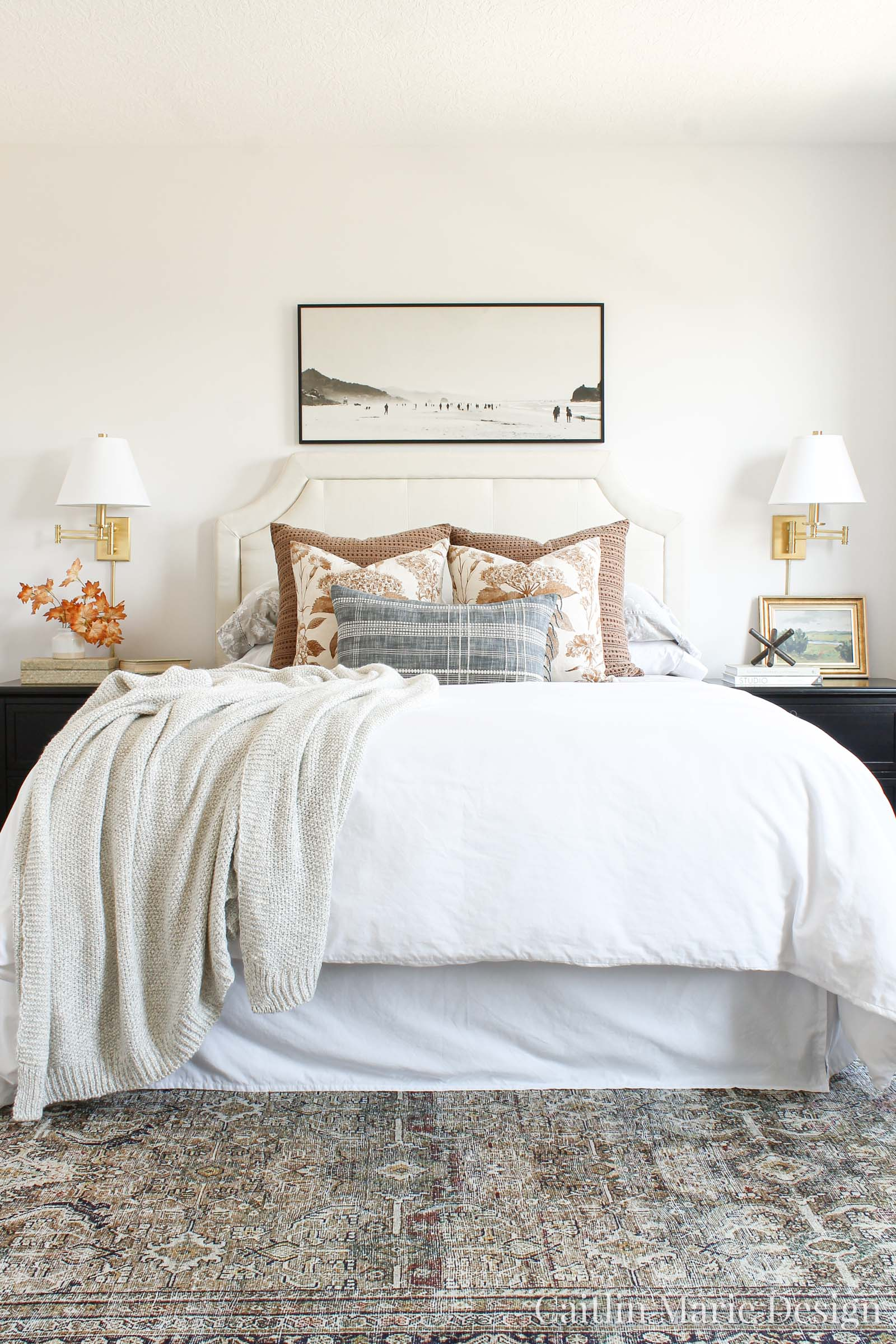 Cozy and Collected Bedroom Styling Tips for Fall | modern traditional decor, vintage style, bedroom wall sconce, art over the bed, layered bedding, sweater throw blanket, Loloi Layla rug, Threshold with Studio McGee
