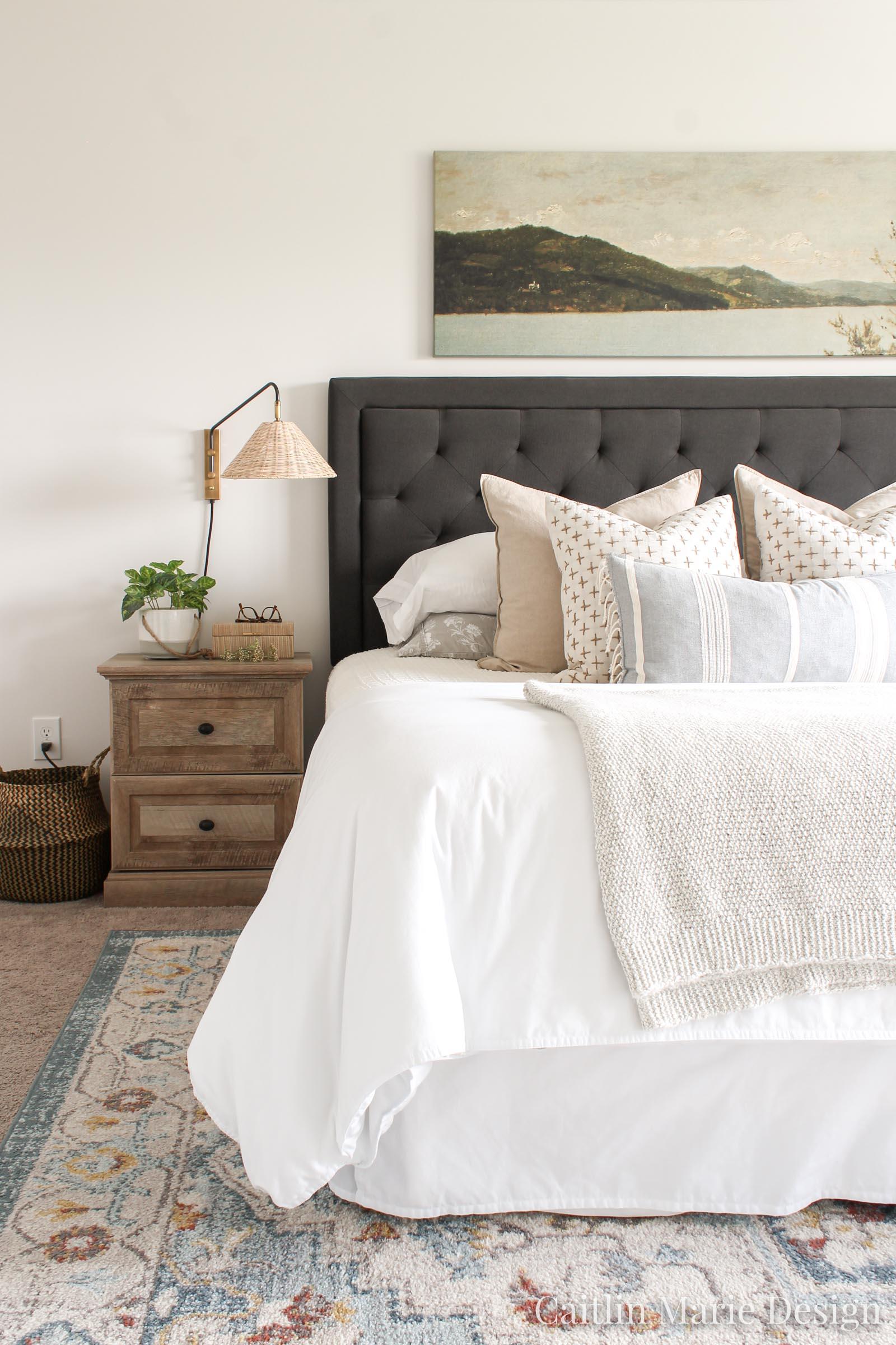 Coastal Master Bedroom Decor, rattan sconces, vintage artwork over the bed