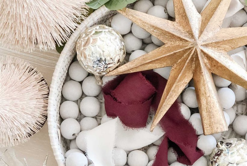 100 Holiday Decor Finds for a Cozy, Minimal Look | wood bead garland, gold star tree topper, bottle brush trees, starburst ornament, modern traditional Christmas, coastal Christmas decor
