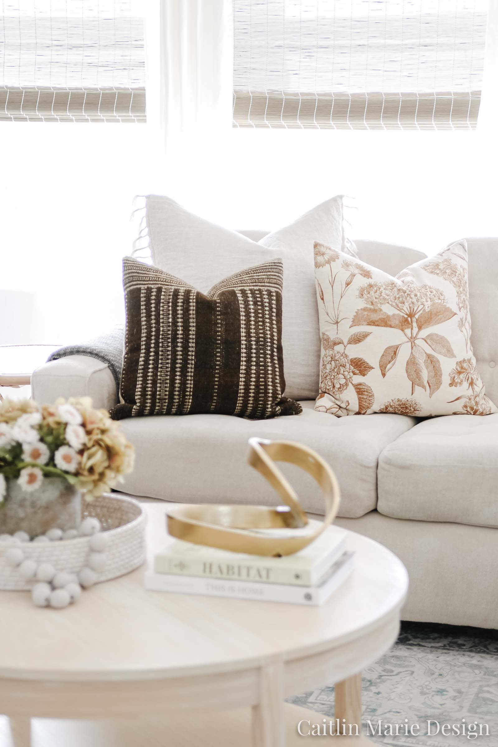 Throw Pillow Combinations for Every Budget | mauve pillow, brown wool striped pillow, round coffee table, plaid pillow, Etsy finds, modern traditional living room