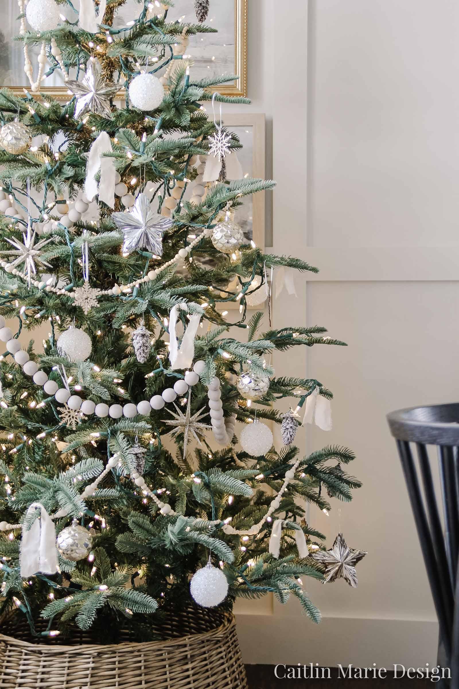 neutral Christmas tree, metallic ornaments, wood bead garland