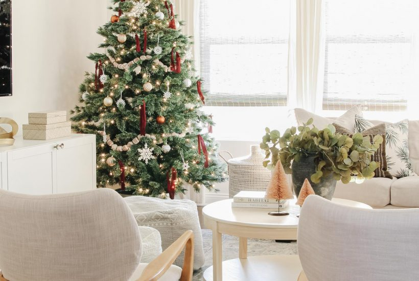 modern Christmas tree, ribbon tied on tree, coastal Christmas, wood accent chairs