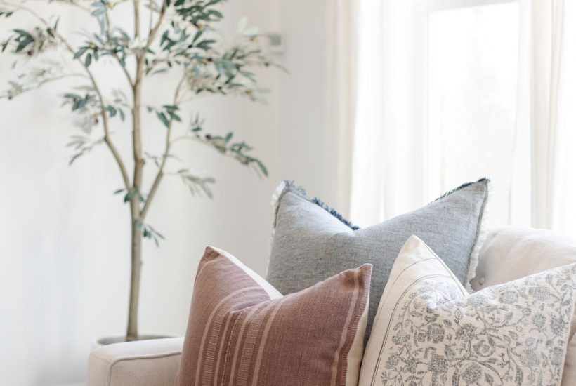 Spring Throw Pillows that Actually Work for Any Season   artificial olive tree, throw pillow combination, cream sofa