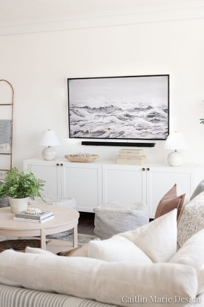 Simple TV Wall Decor - modern media console, round coffee table, coastal art displayed on smart tv