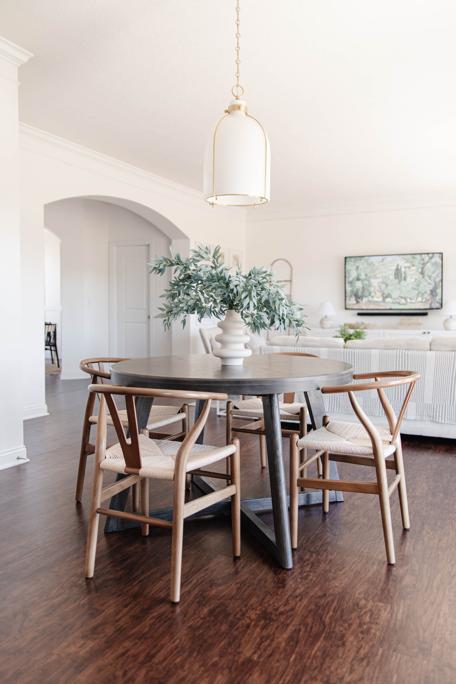 Breakfast Table Update with Overstock | round breakfast table, wishbone chairs, brass pendant light, faux greenery
