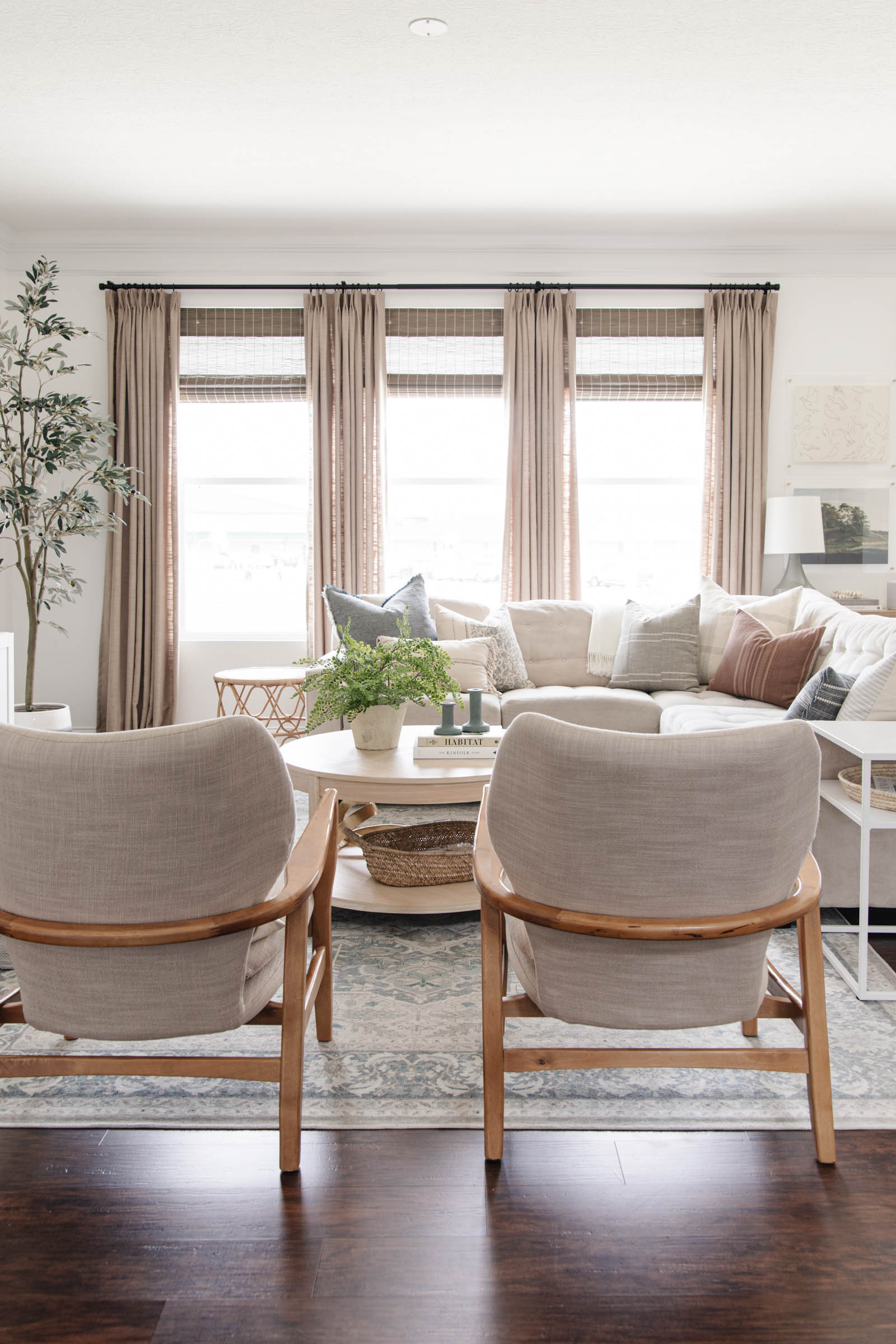 coastal casual living room with beige curtains