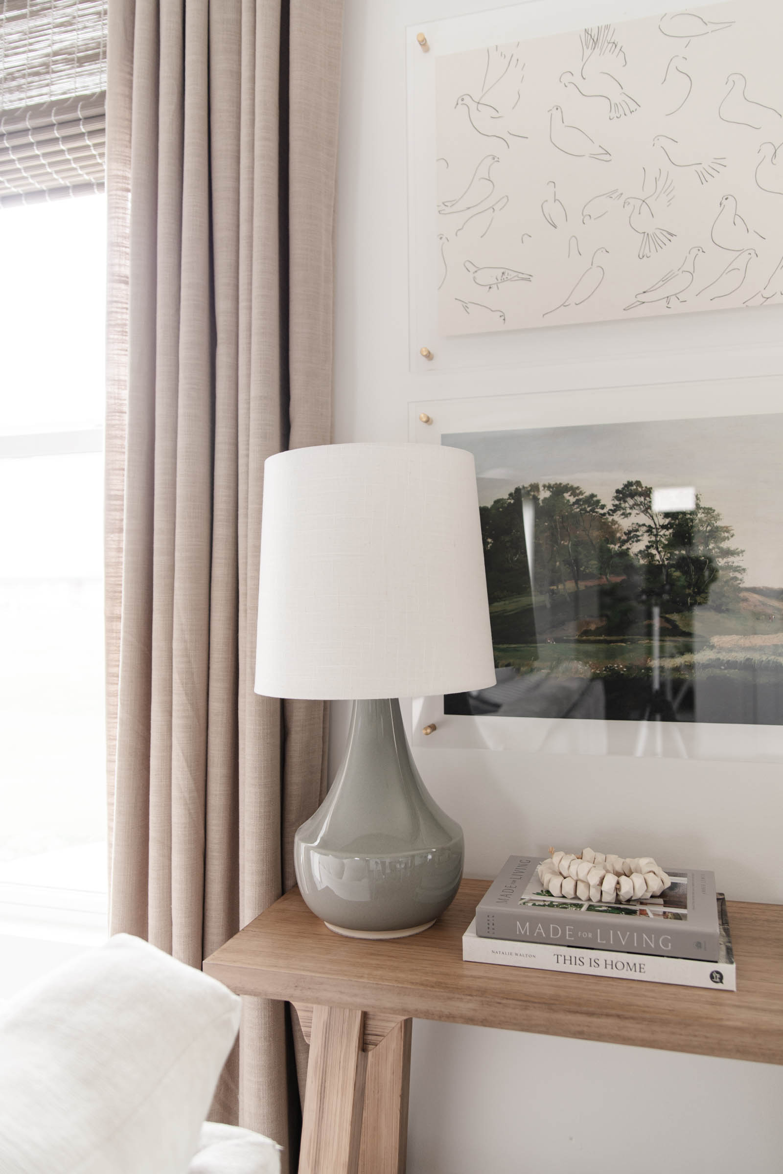 small console table with gray lamp, gray beige curtains