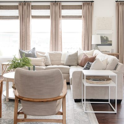 living room with beige curtains entry image