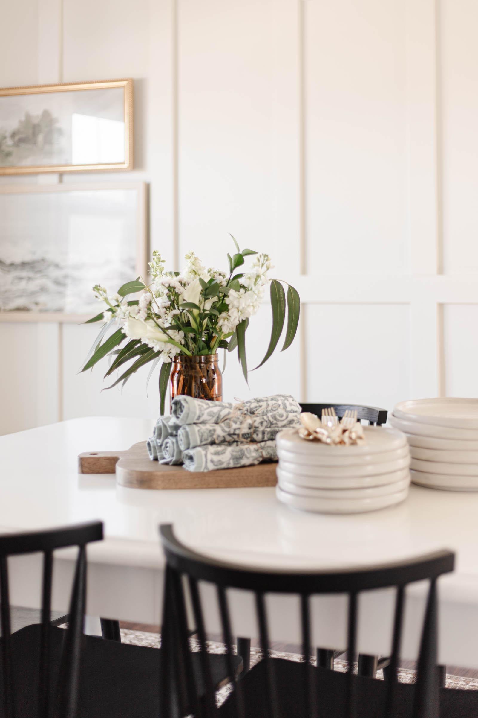 tables cape staples: dinner and salad plates, cloth napkins, flatware, centerpiece