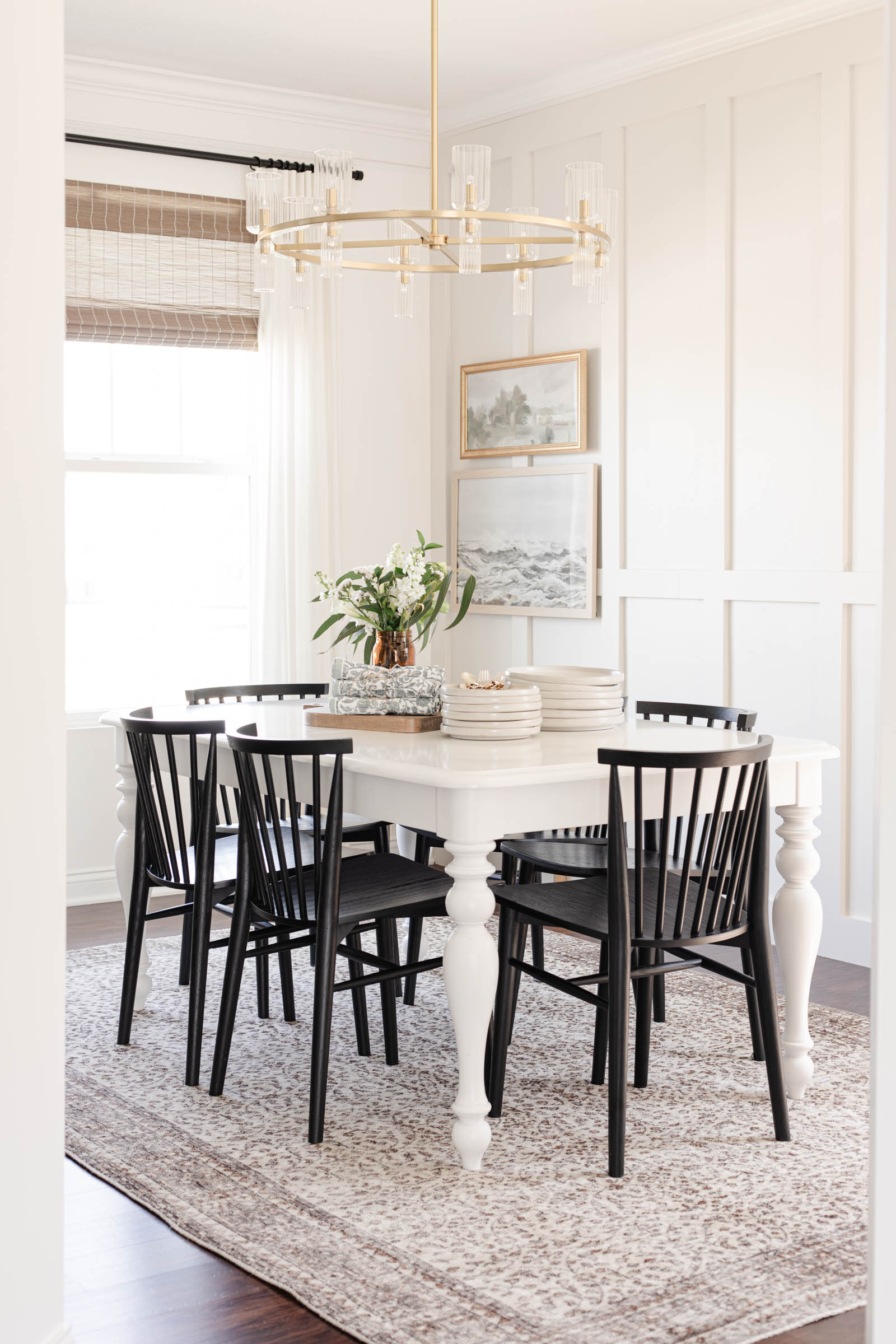 Casual Tablescape for Spring and Summer | neutral dining room, board and batten, black dining chairs