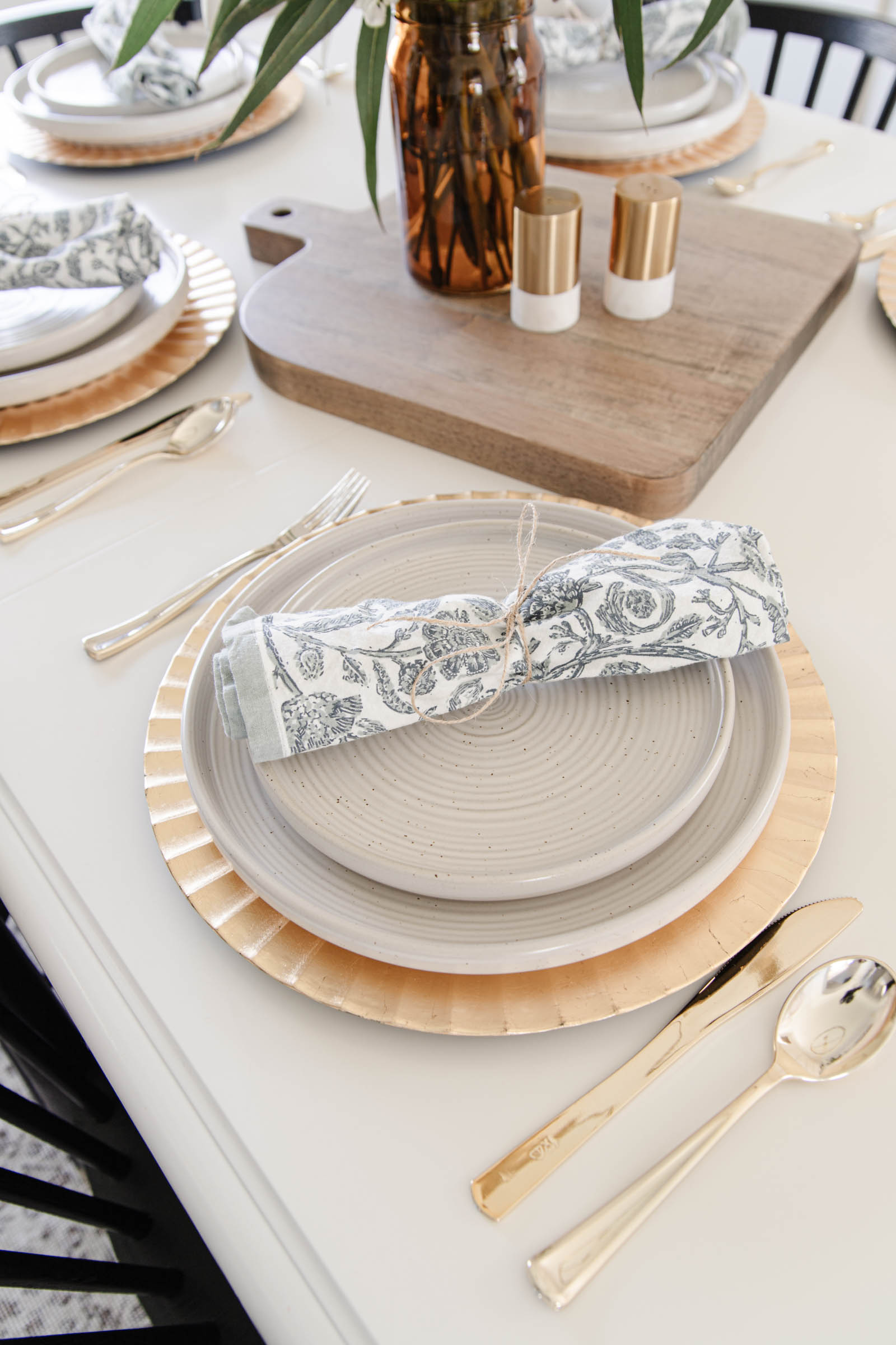 close up of plate charge, dinner plate, salad plate, and cloth napkin