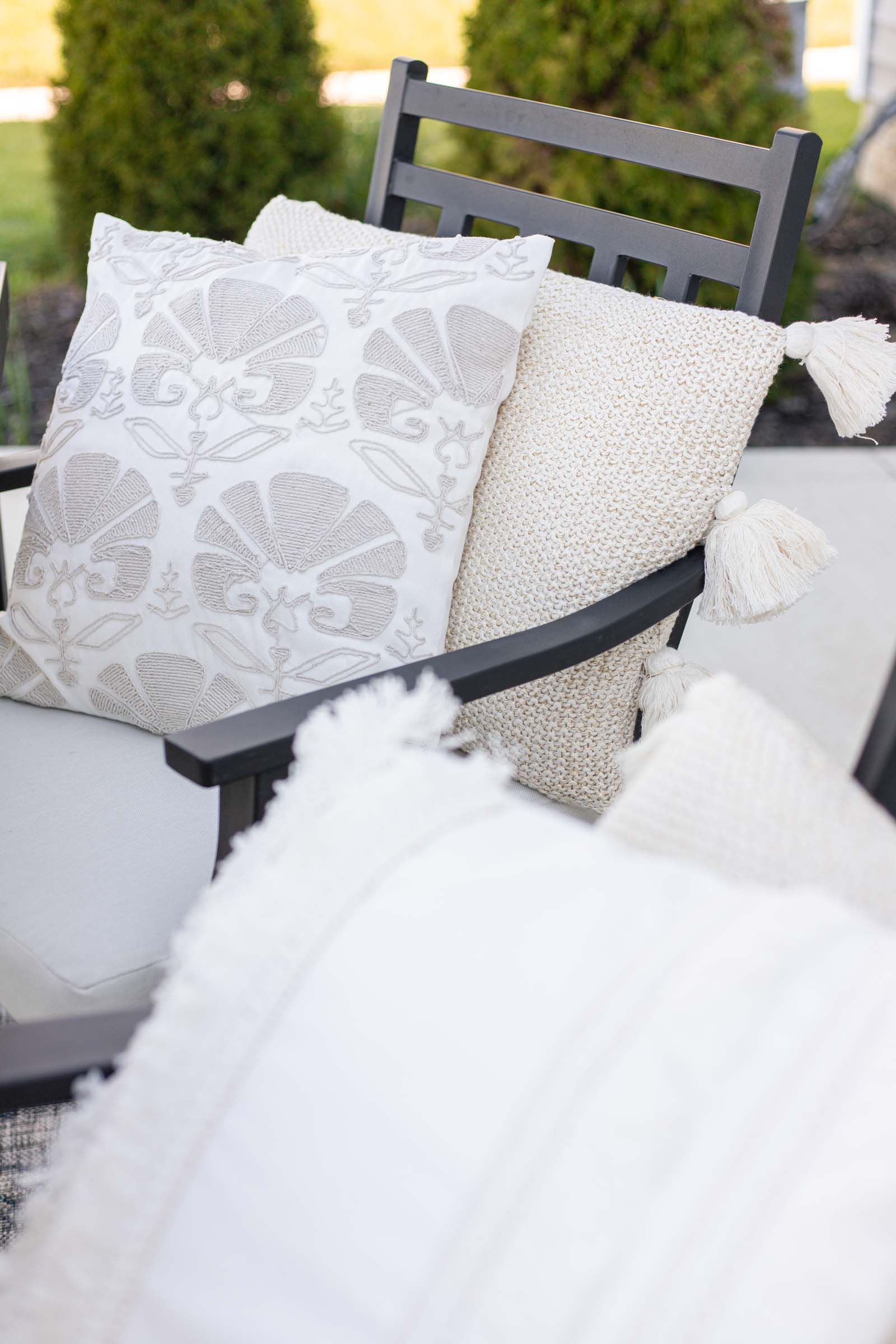 beige and white decorative pillows