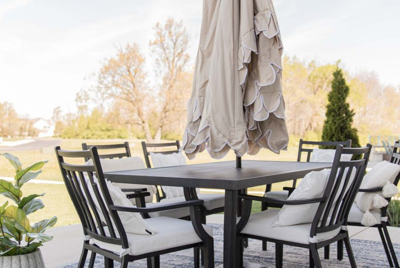 Simple Patio Decorating Ideas   beige umbrella with scalloped edge, blue outdoor rug, pillows