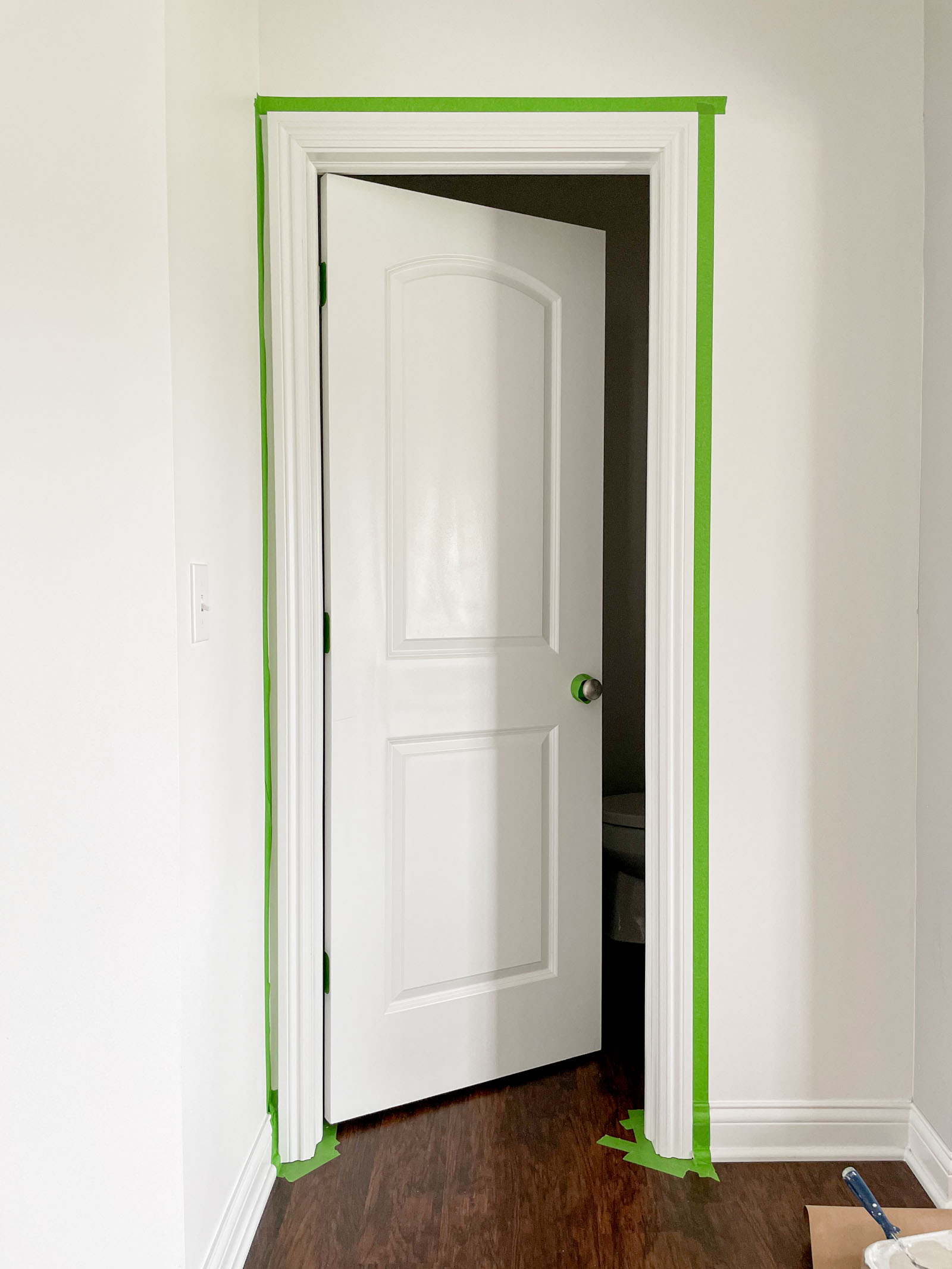 Door lined with painters tape