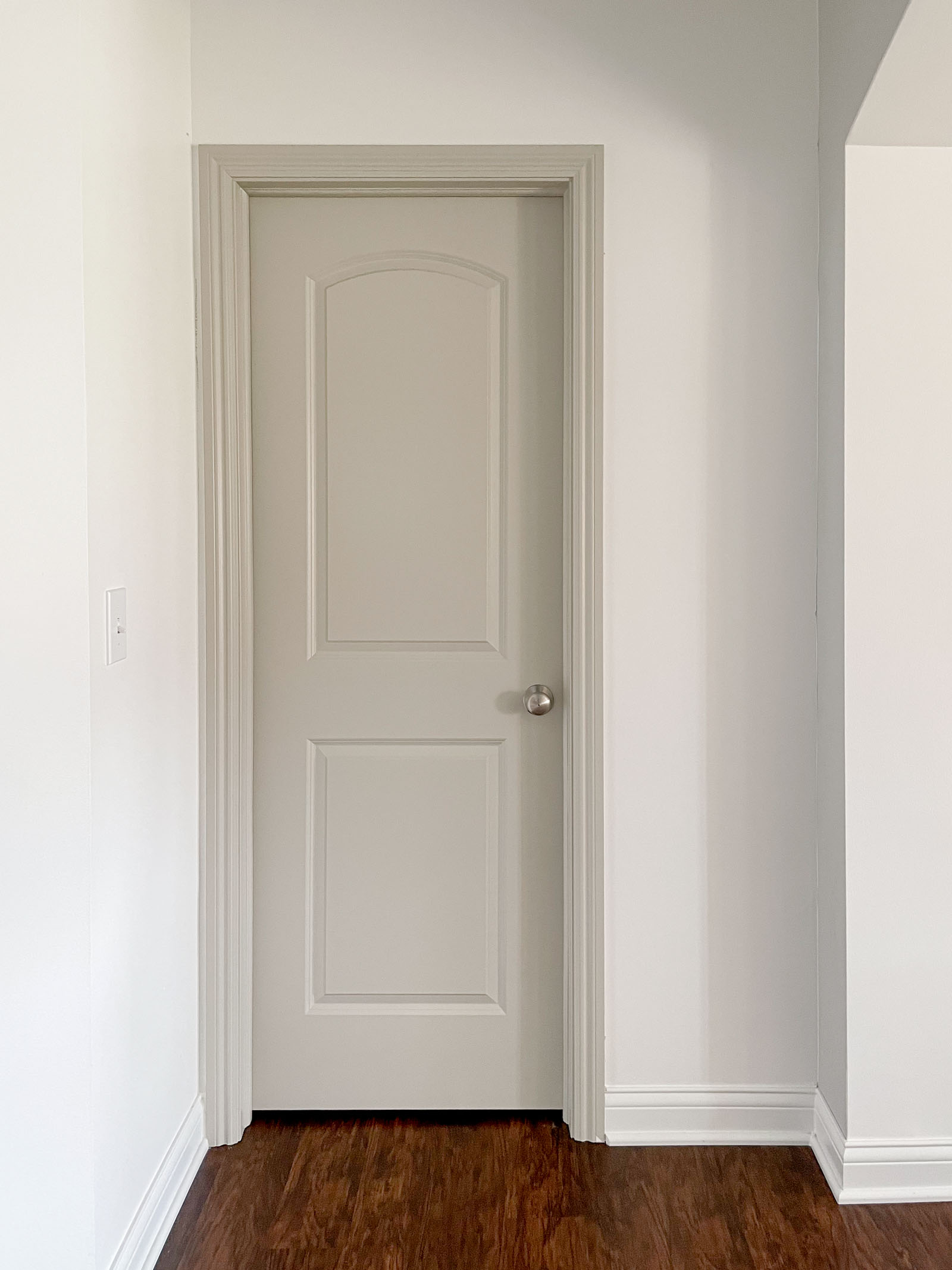 How to Paint Interior Doors | Revere Pewter by Benjamin Moore, greige paint, greige door, painted interior door and trim
