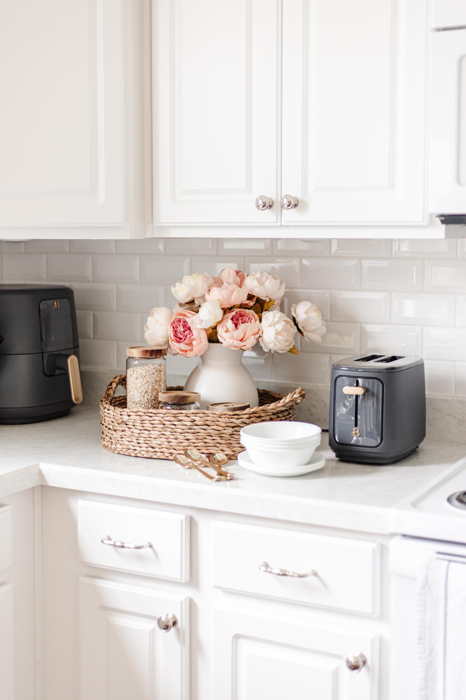 breakfast station for hosting guests, beautiful touchscreen toaster from Walmart, water hyacinth woven tray, glass canister set, white ceramic vase