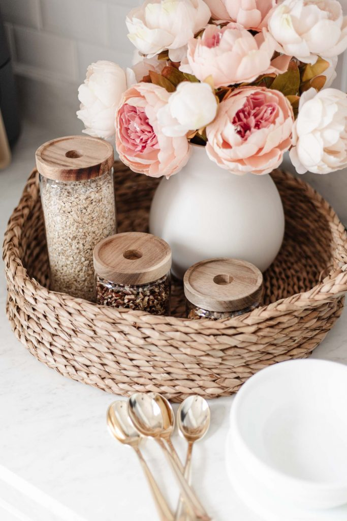 breakfast station for hosting guests, Walmart kitchen decor, water hyacinth woven tray, glass canister set, white ceramic vase
