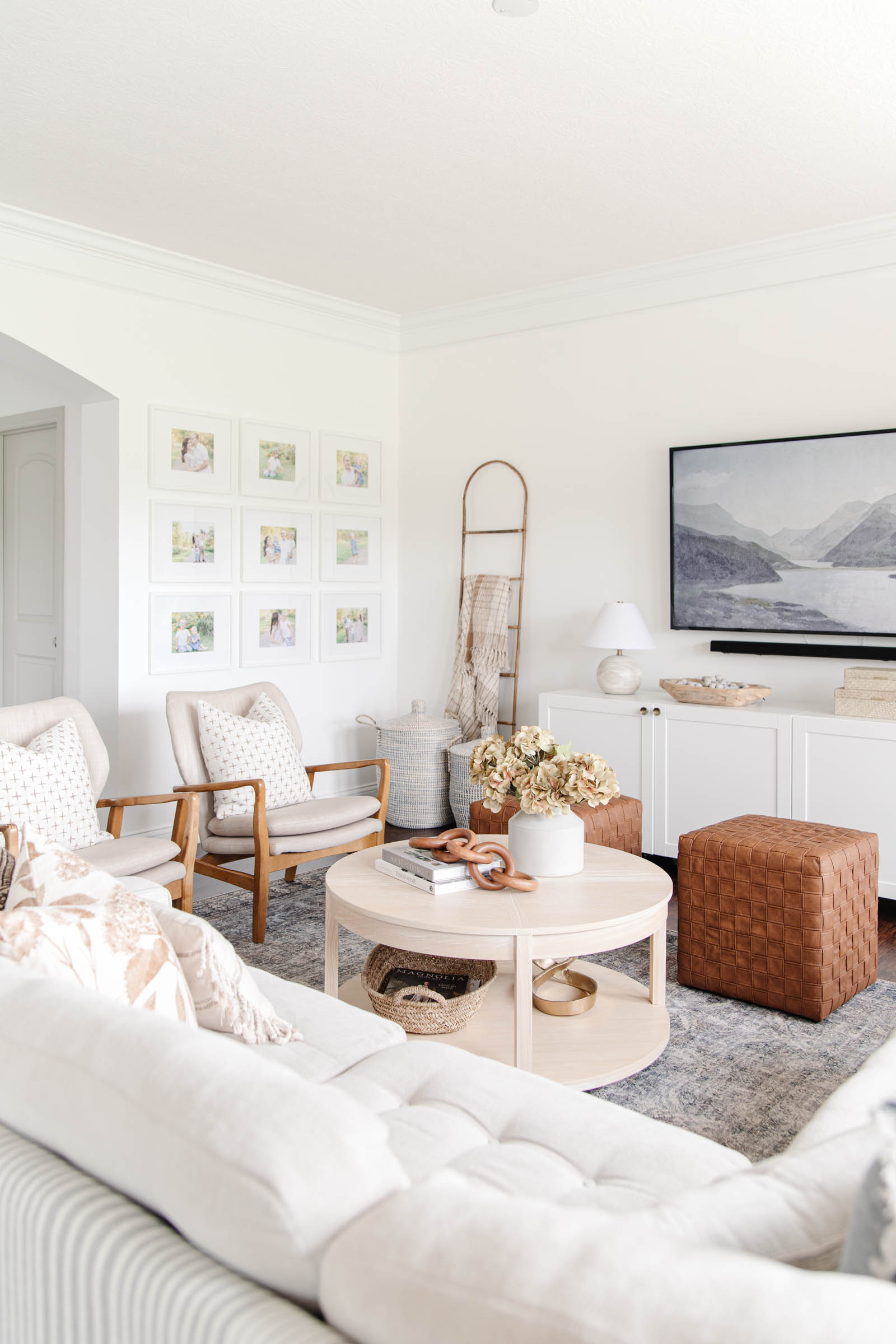 modern media console, faux leather woven cubes, family photo gallery wall, cozy fall aesthetic living room